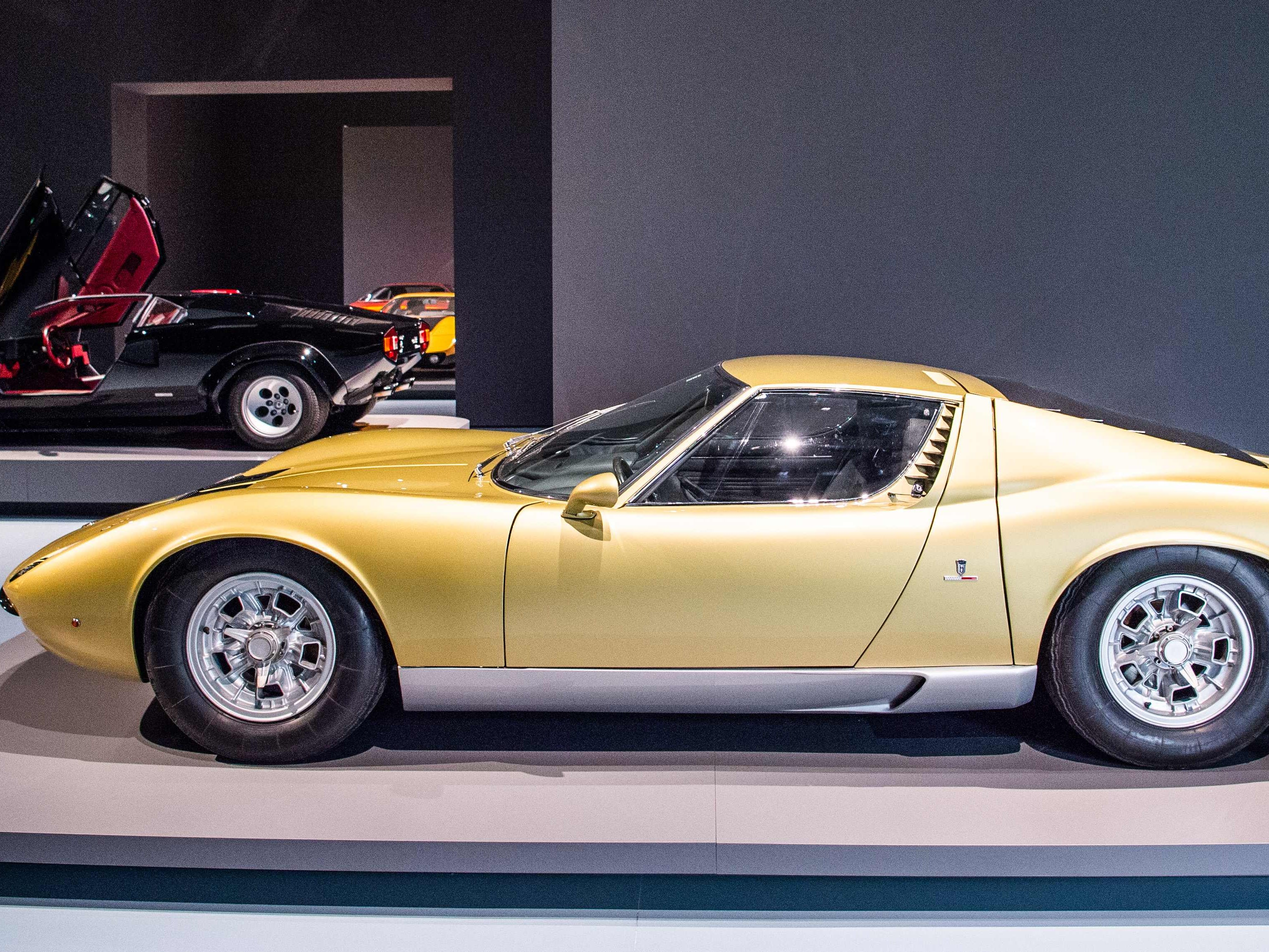 "A golden Lamborghini Miura P400 (foreground) and a Lamborghini Countach 5000 QV are on display at the exhibition ""PS: Ich liebe Dich"" (CARS - Driven by Design - Sports Cars from the 1950s to the 1970s) at the Museum Kunstpalast in Duesseldorf, western Germany, on Sept. 26, 2018."