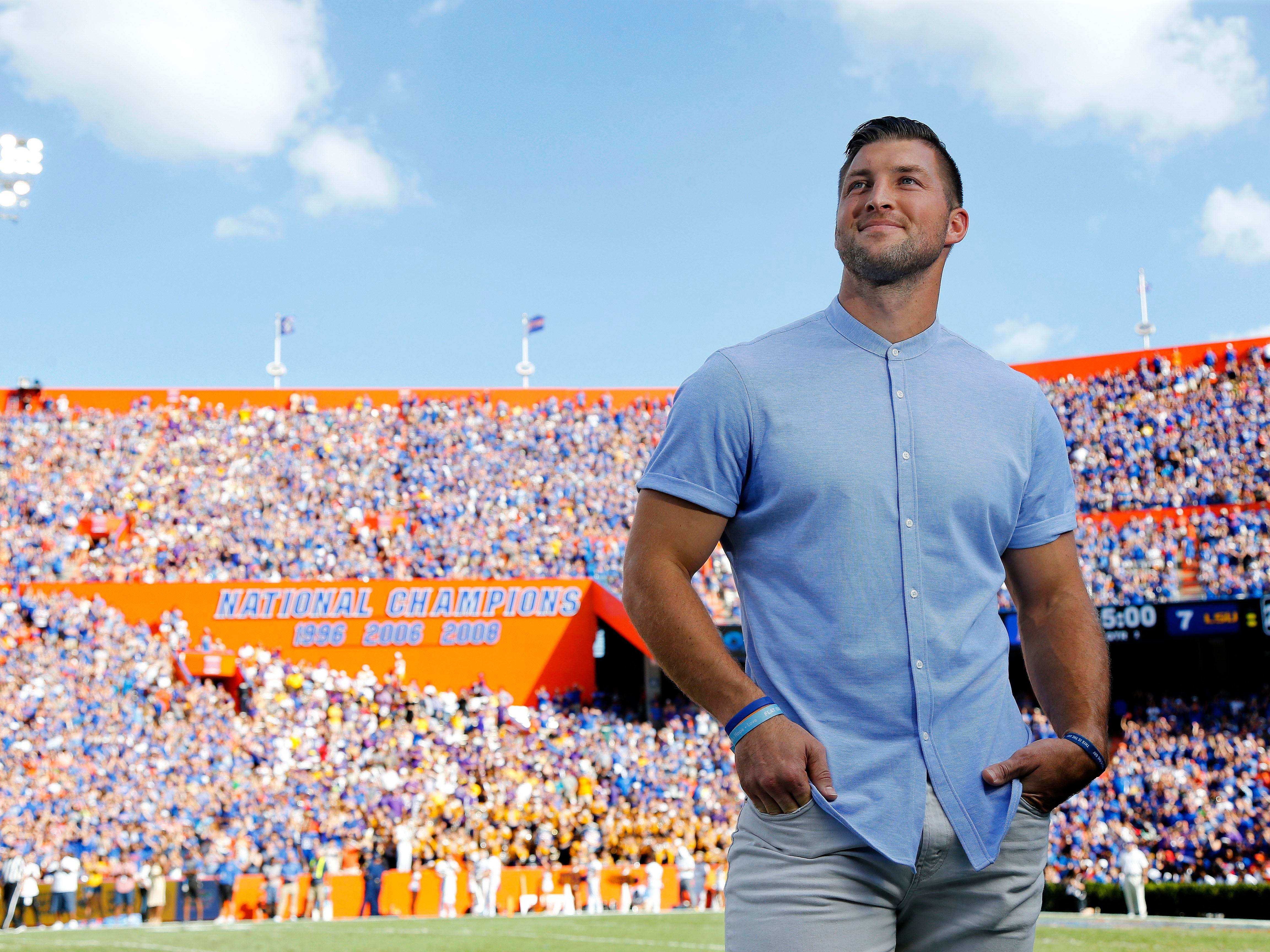 Florida Gators former quarterback Tim Tebow is inducted into the Ring of Honor at the end of the first quarter against the LSU Tigers at Ben Hill Griffin Stadium.