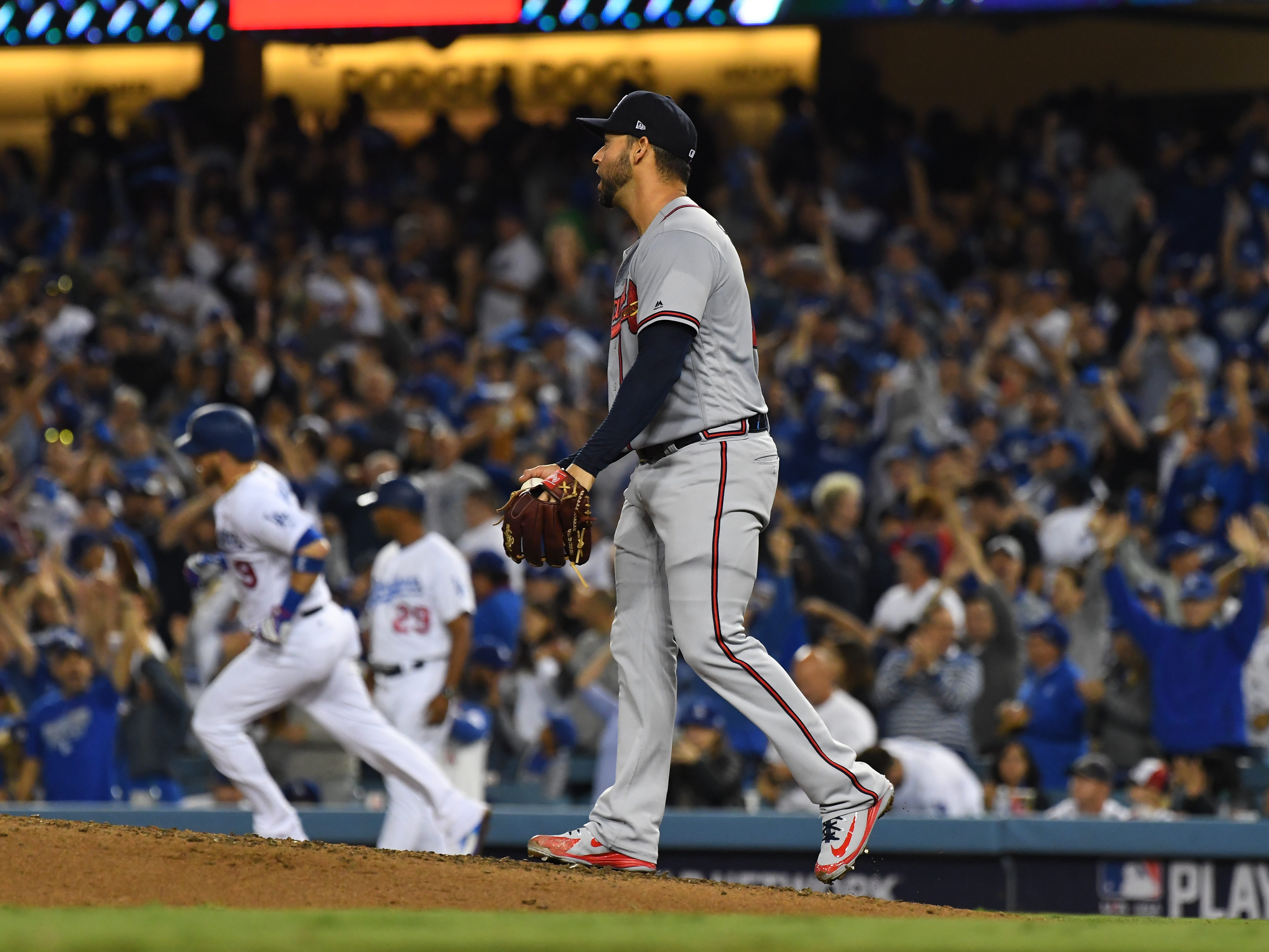 NLDS Game 2: Braves starting pitcher Anibal Sanchez looks on as Dodgers catcher Yasmani Grandal rounds the bases after hitting a home run in the fifth inning.