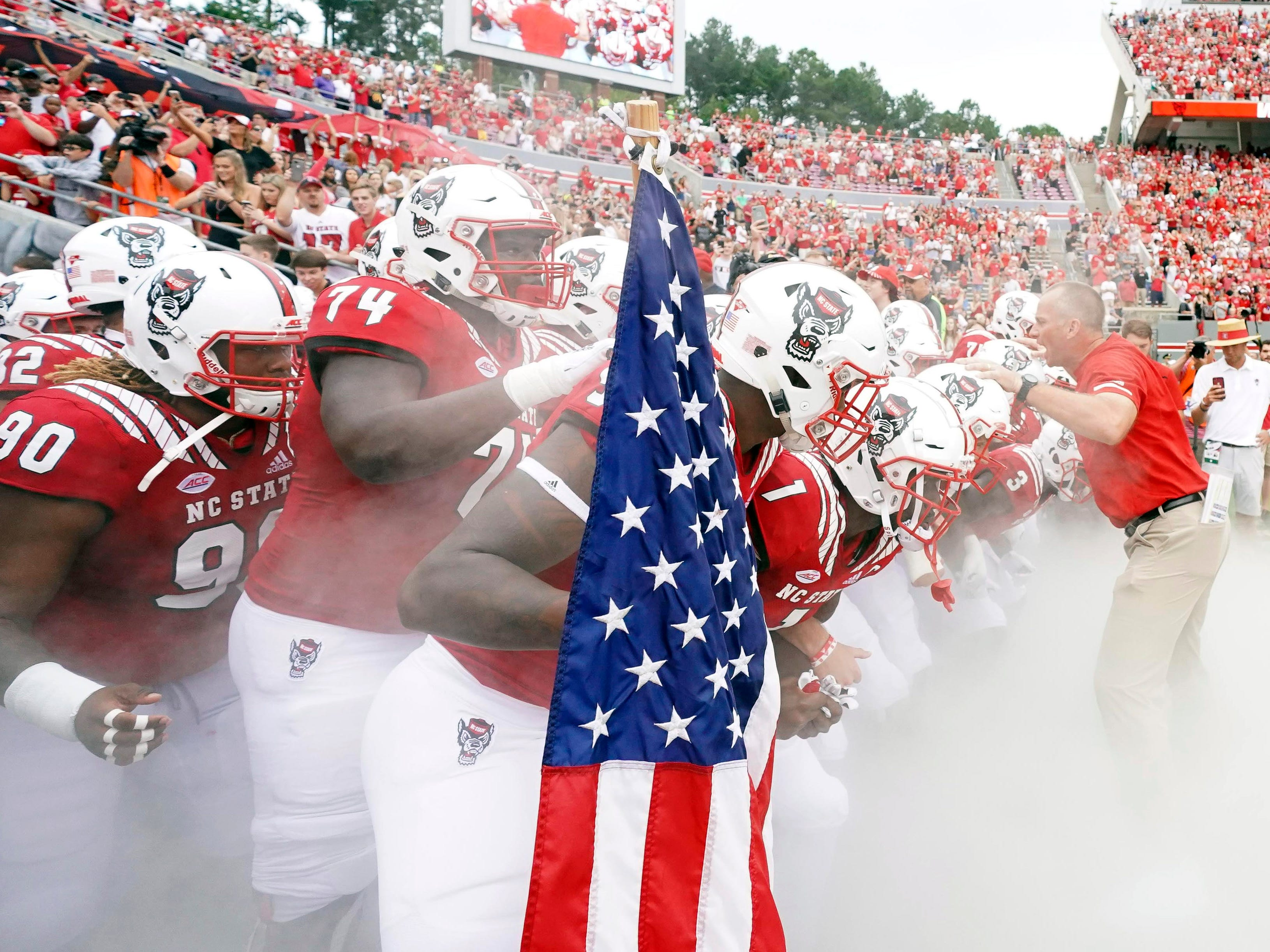 North Carolina State Wolfpack players come out onto the field before the game against the Boston College Eagles at Carter-Finley Stadium.