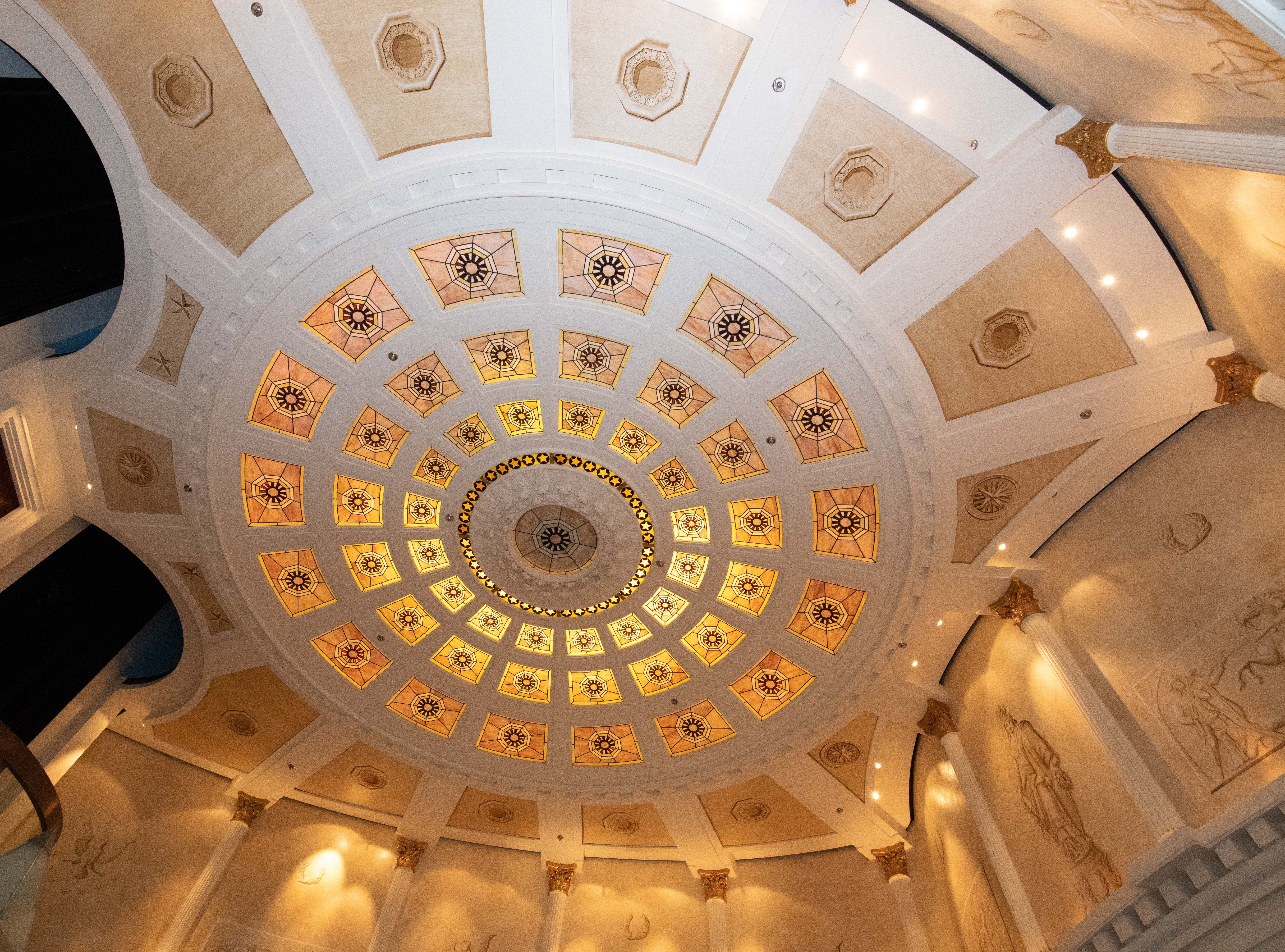 An elegant ceiling with back-lit glass tops the Capitol Atrium.