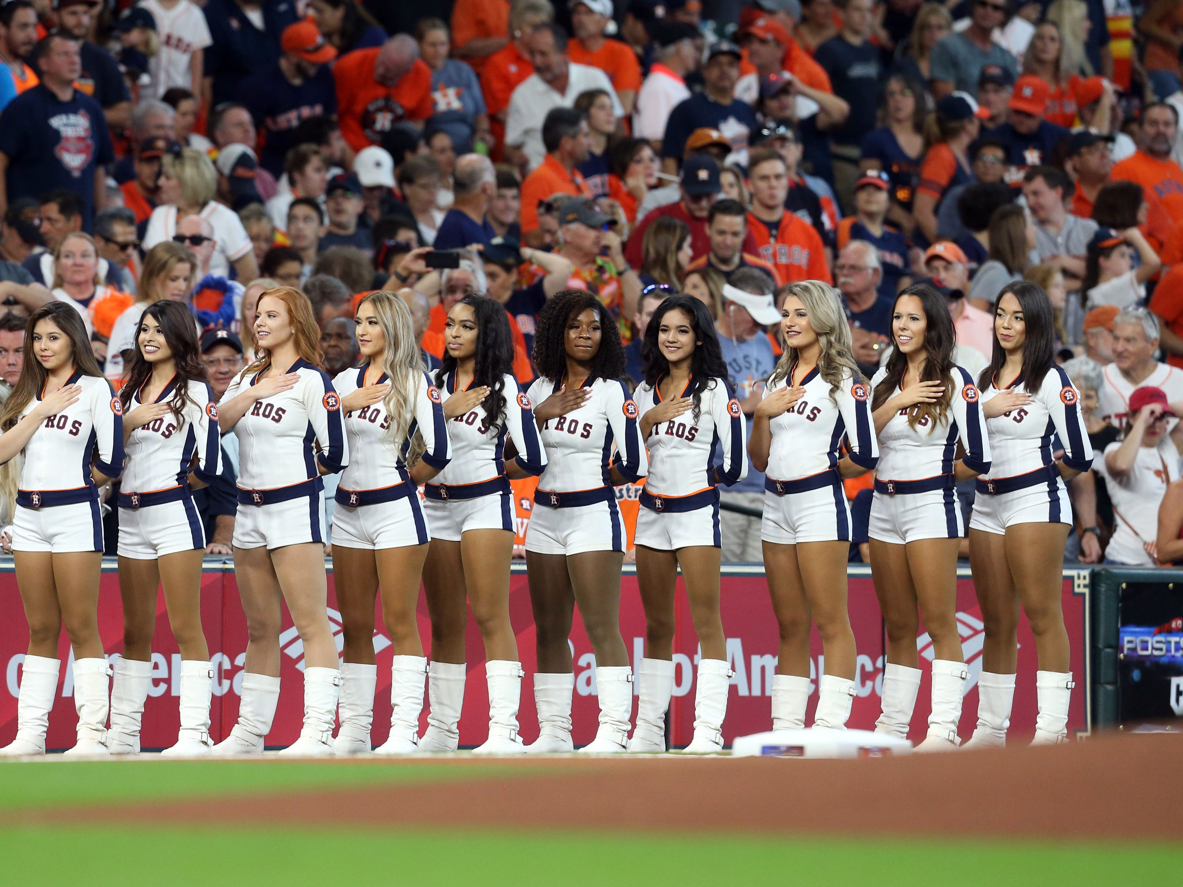 ALDS Game 2: Astros cheerleaders stand for the national anthem.