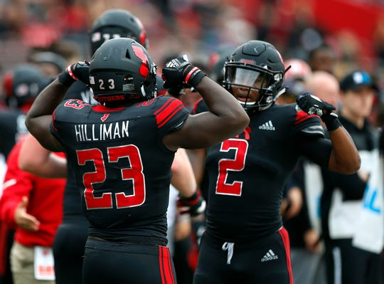 Rutgers Scarlet Knights running back Jonathan Hilliman and back Raheem Blackshear celebrate after a touchdown against Illinois Fighting Illini during first half at High Point Solutions Stadium.