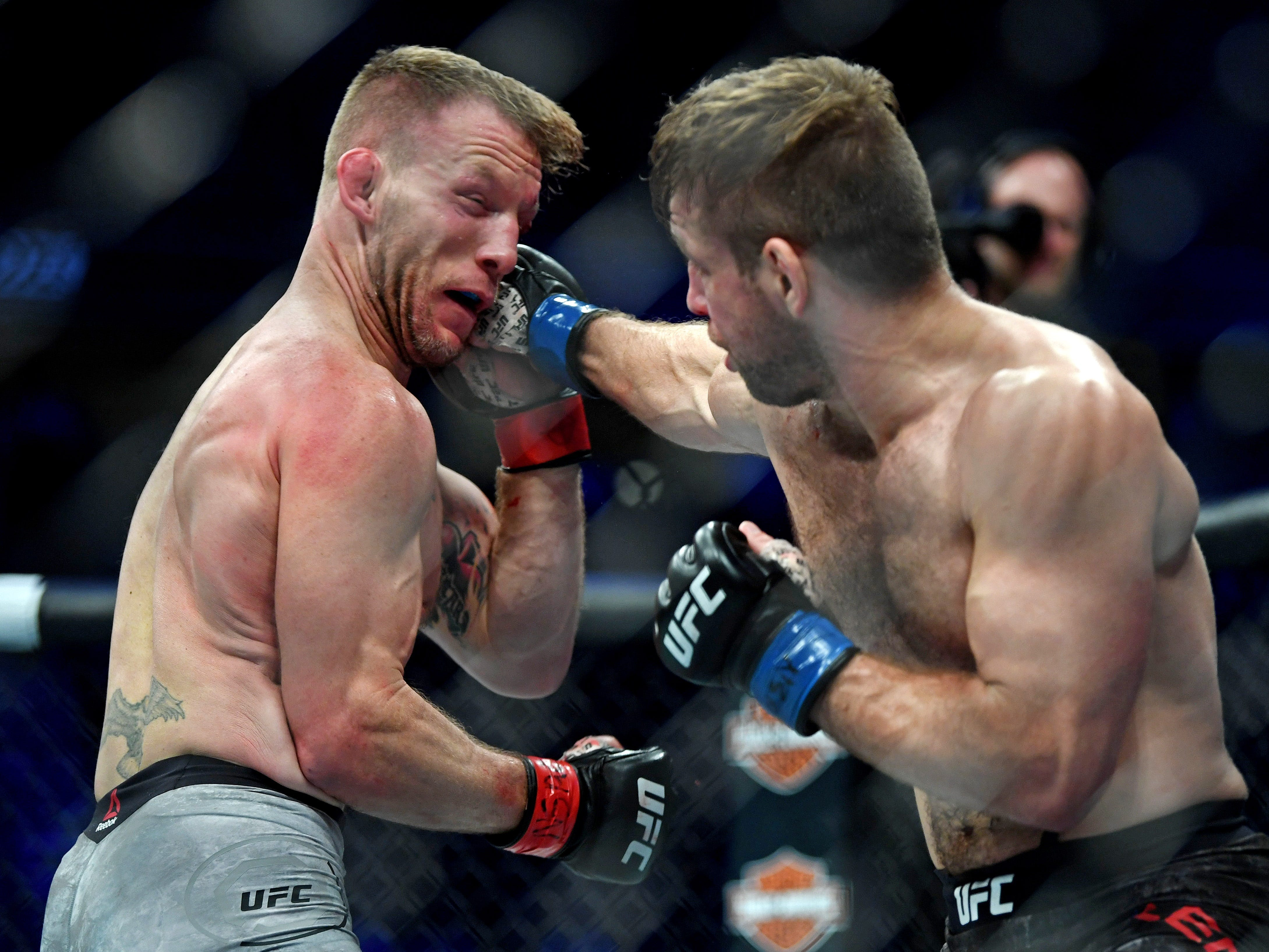 Nik Lentz, right, lands a punch against Gray Maynard during their lightweight fight.