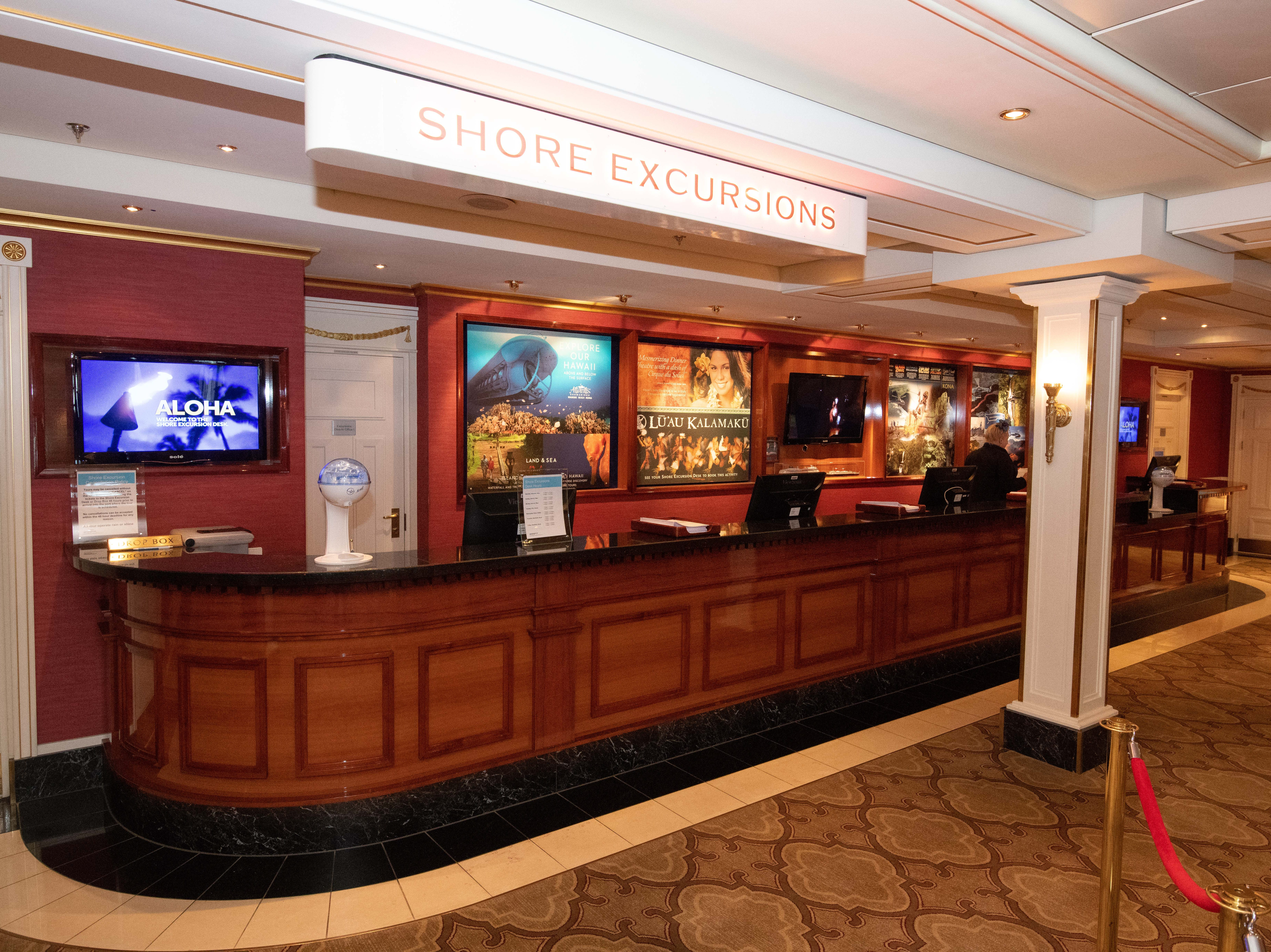 Passengers can arrange shore tours at the Shore Excursions desk located on the ground level of the Capitol Atrium.