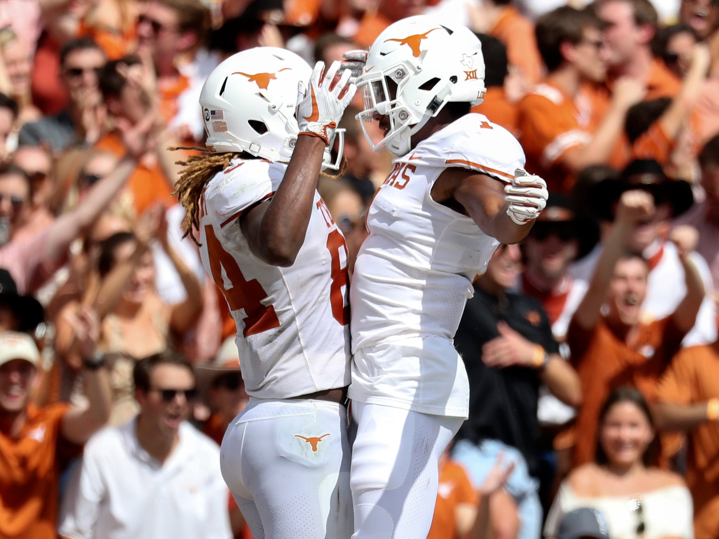 Texas Longhorns wide receiver Lil'Jordan Humphrey celebrates with teammates after scoring a touchdown during the second half against the Oklahoma Sooners at the Cotton Bowl.