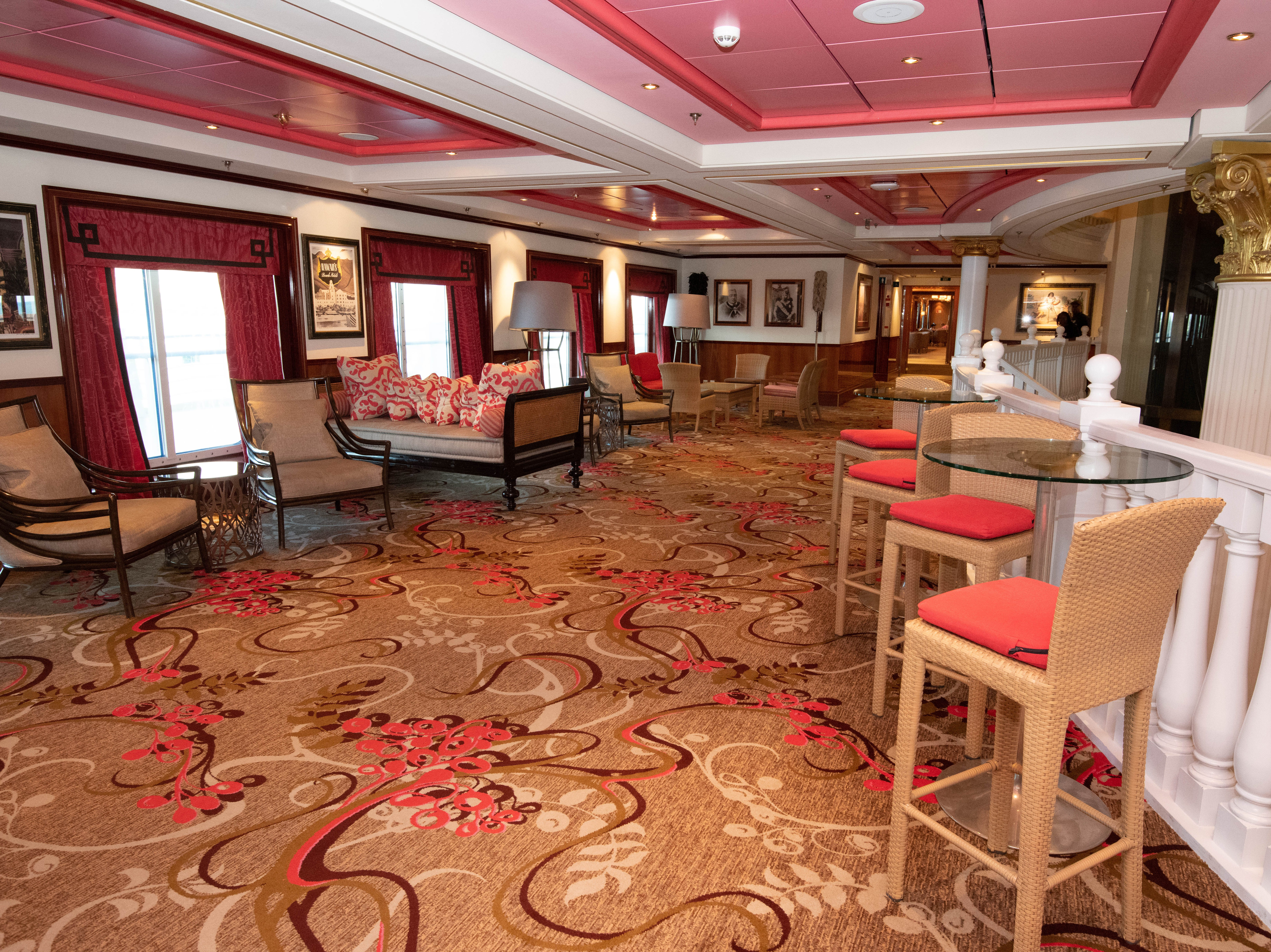 Overlooking the Capitol Atrium on Deck 6 is a large lounge area known as Pink's Champagne Bar.