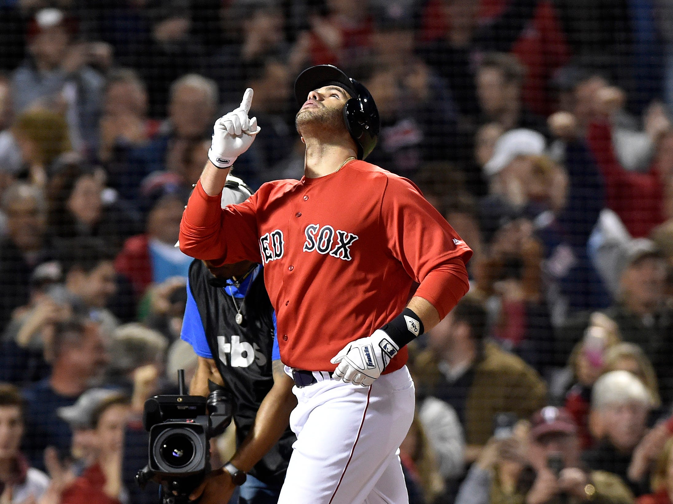 ALDS Game 1: Red Sox designated hitter J.D. Martinez slugs a three-run home run in the first inning.