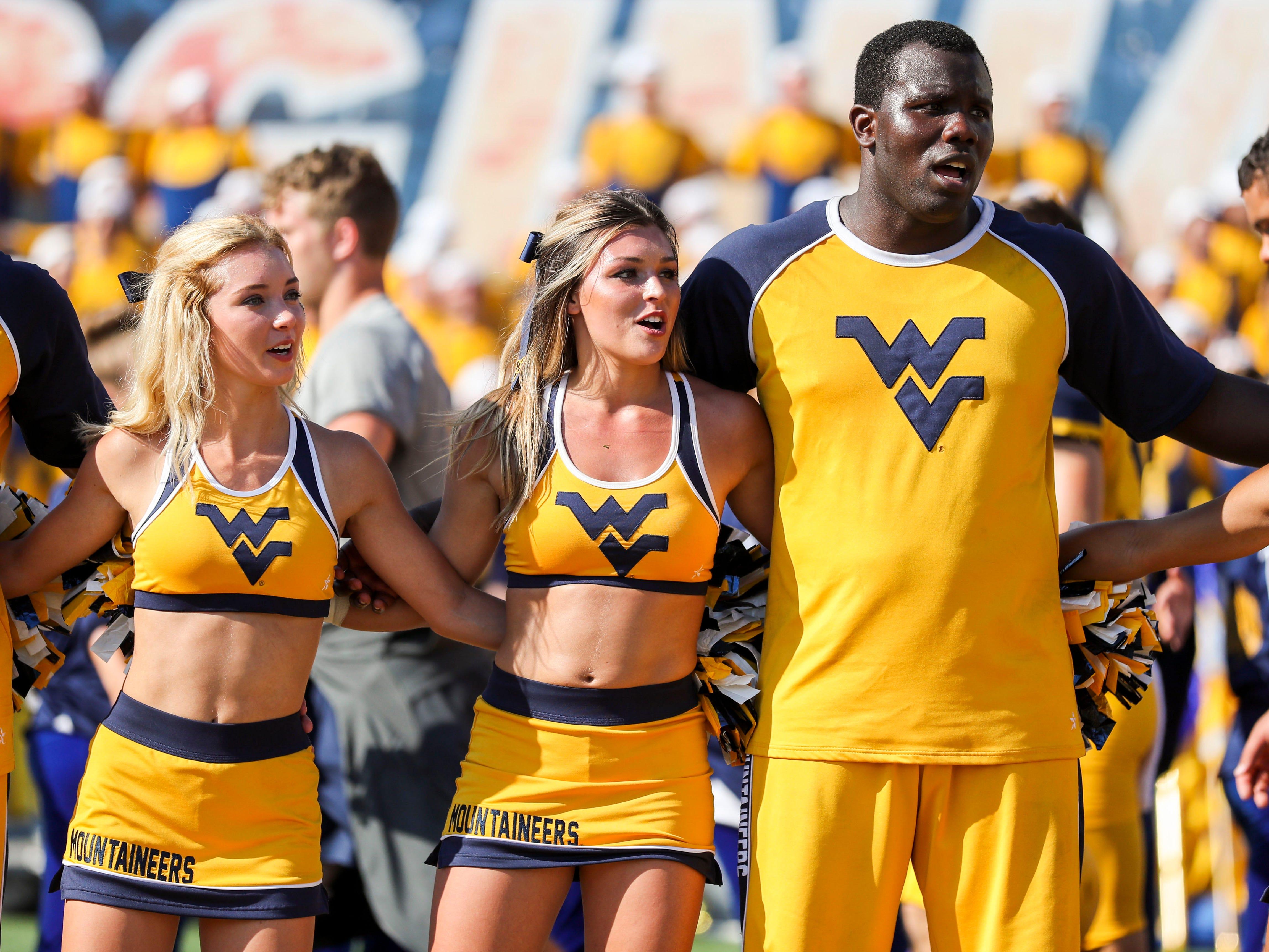 Week 6: West Virginia Mountaineers cheerleaders celebrate after beating the Kansas Jayhawks at Mountaineer Field at Milan Puskar Stadium.