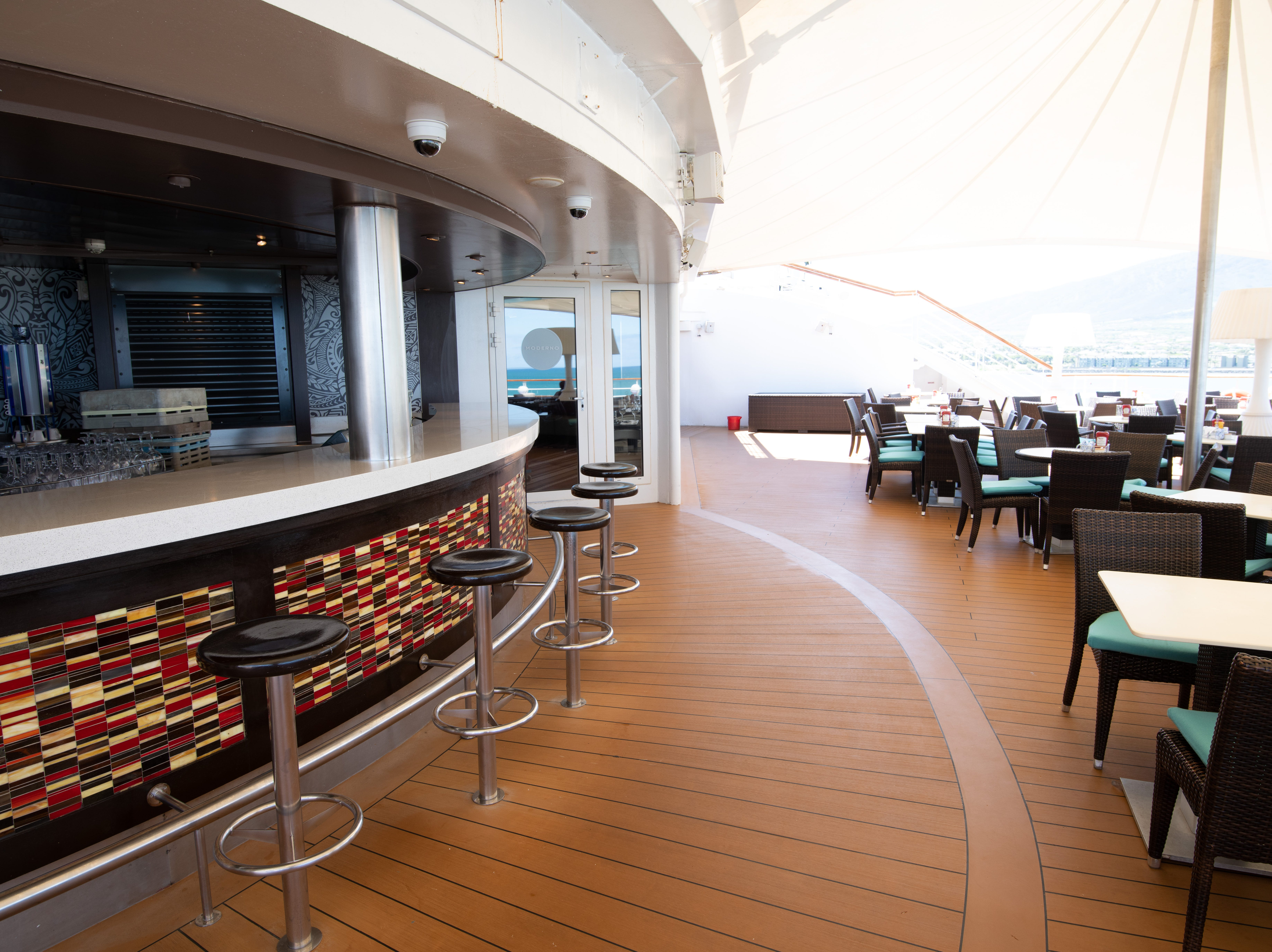 Outdoor seating for the Aloha Cafe is located at the back of the ship on Deck 11.