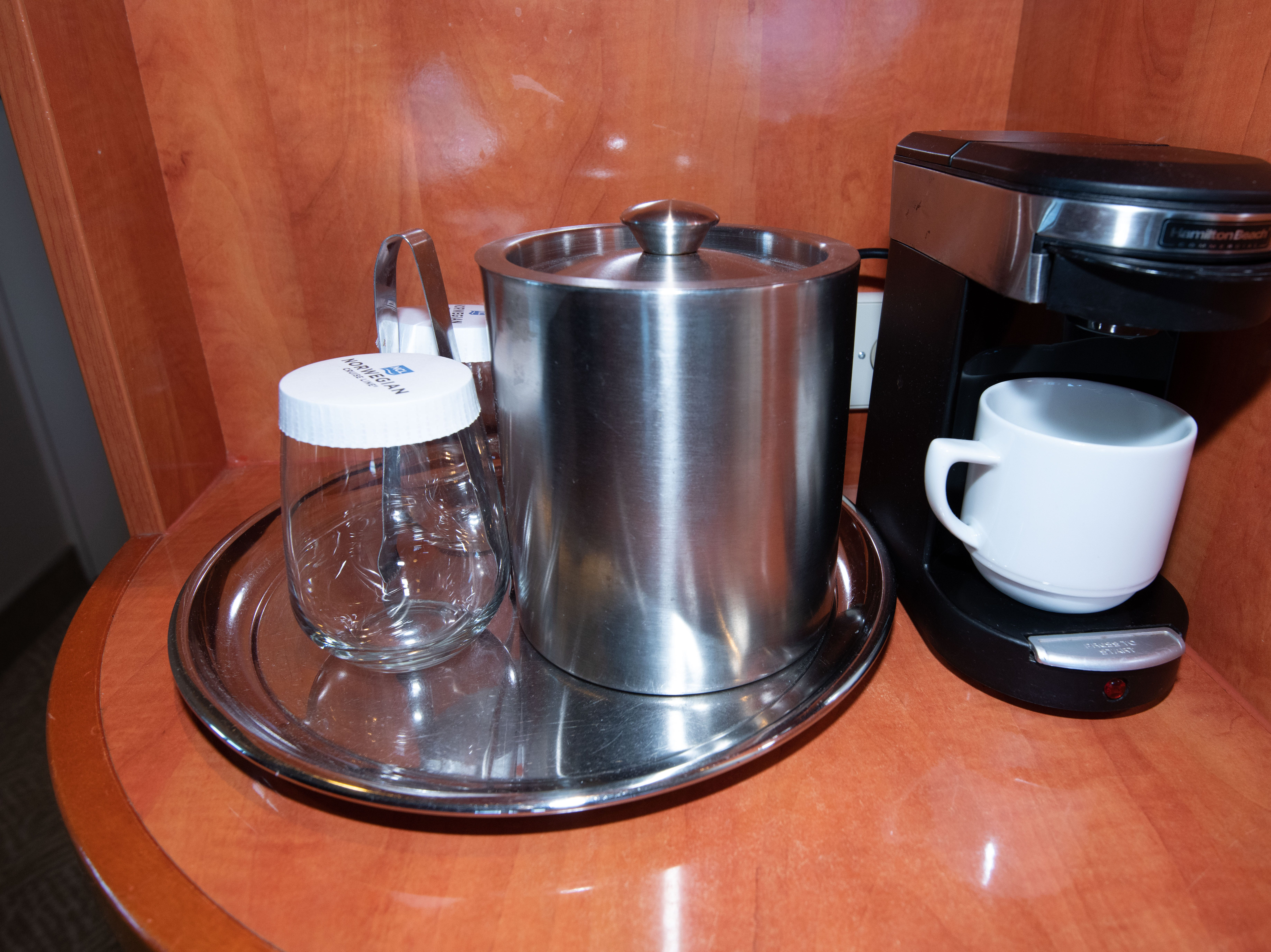 Single-serve coffee makers and ice buckets are standard features in Pride of America cabins.