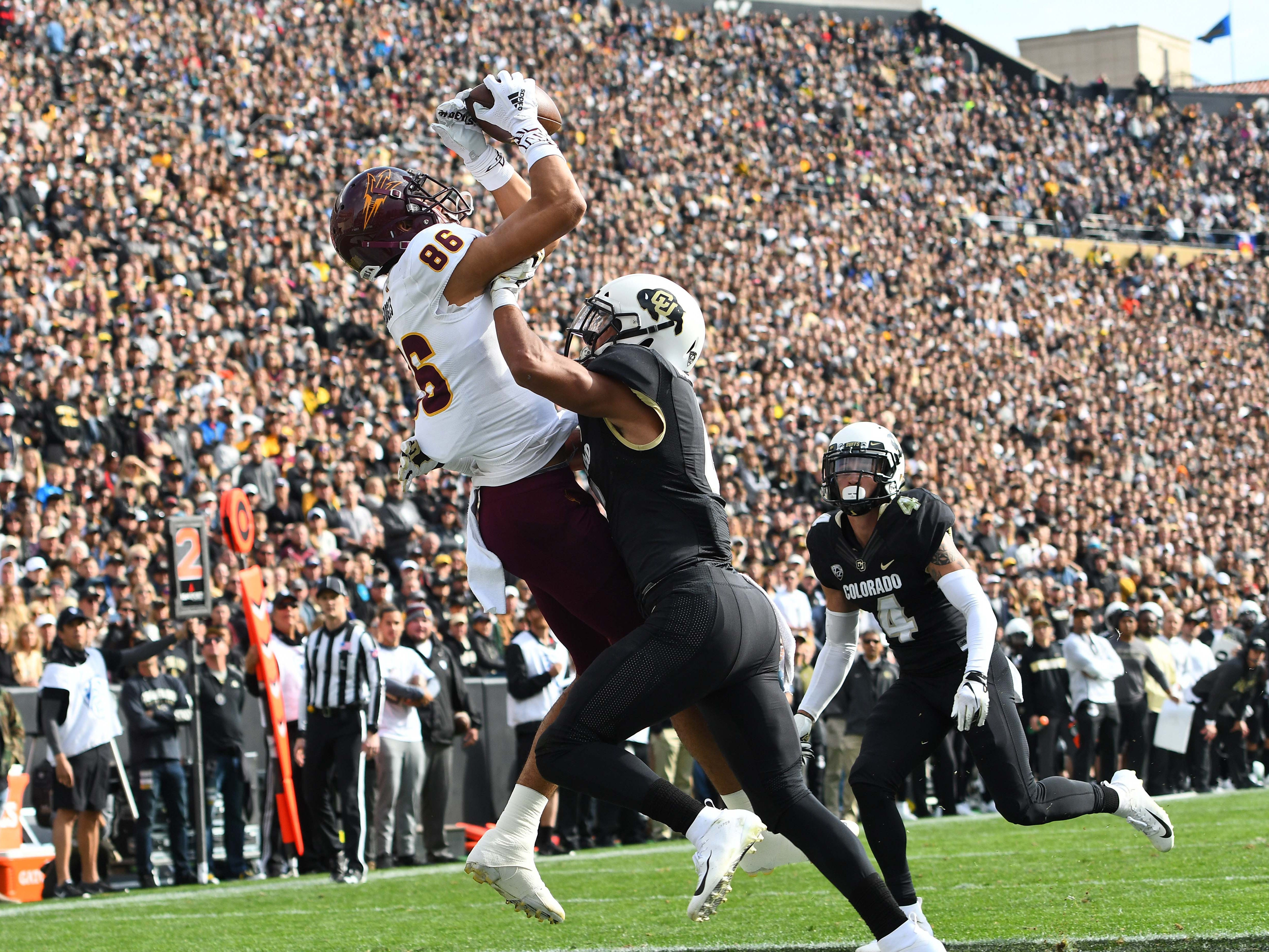 Arizona State Sun Devils wide receiver Tannor Park touchdown reception attempt is broken up by Colorado Buffaloes defensive back Evan Worthington in the second quarter at Folsom Field.