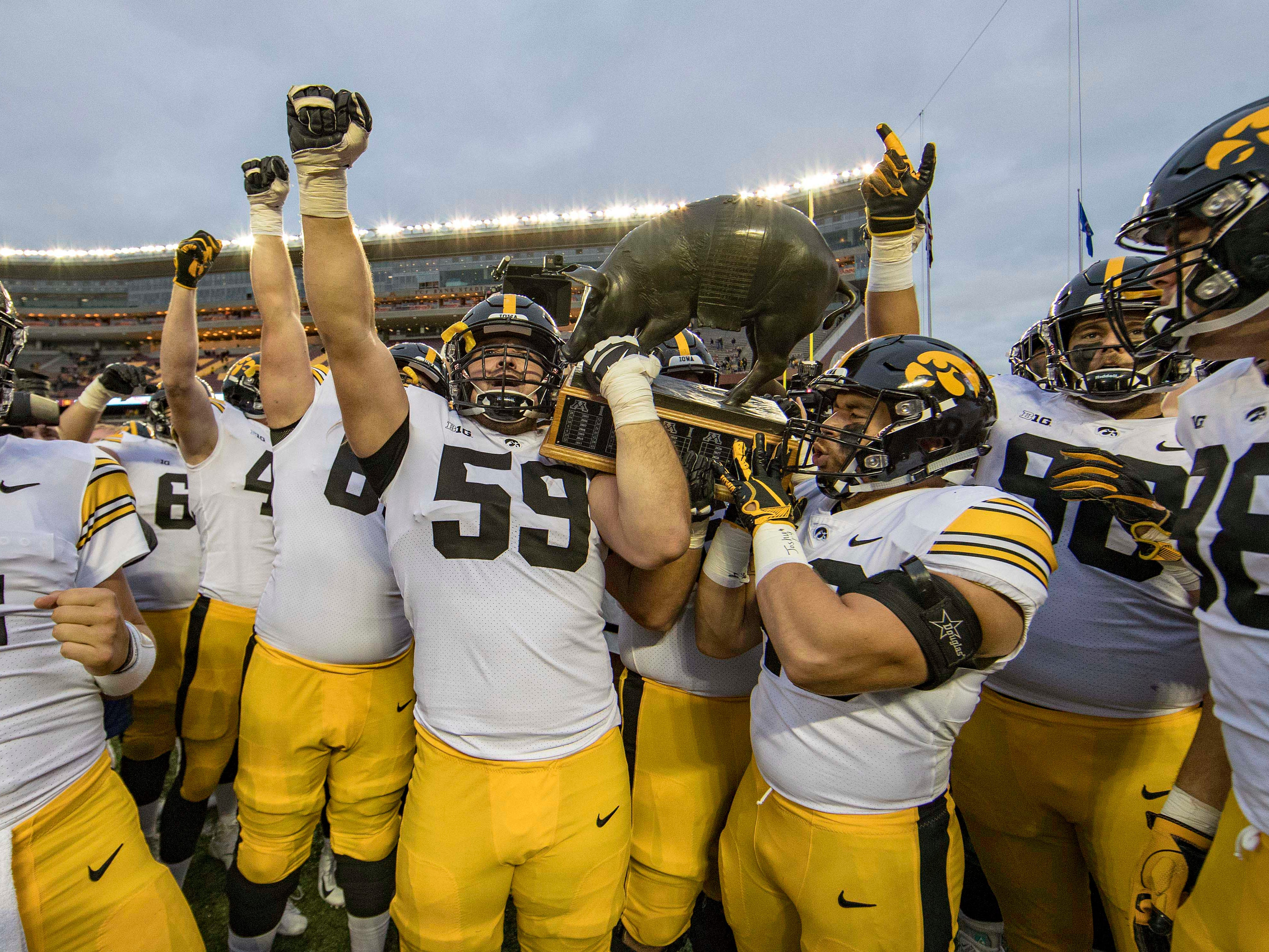 A general view of the Iowa Hawkeyes lifting up the Floyd of Rosedale trophy at TCF Bank Stadium.
