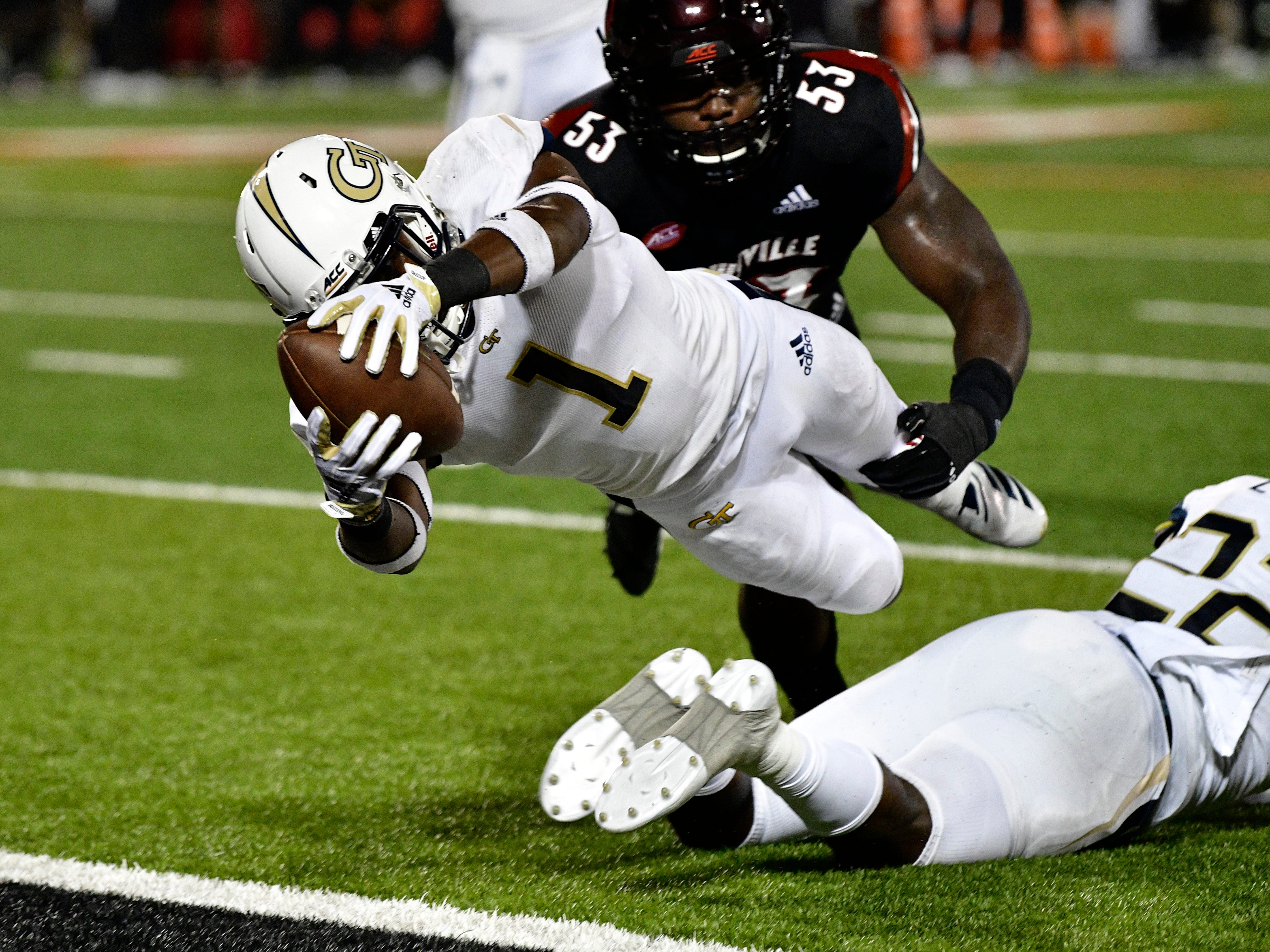 Georgia Tech running back Qua Searcy (1) dives into the end zone for a touchdown past Louisville defender Amonte Caban (53) during the second half.