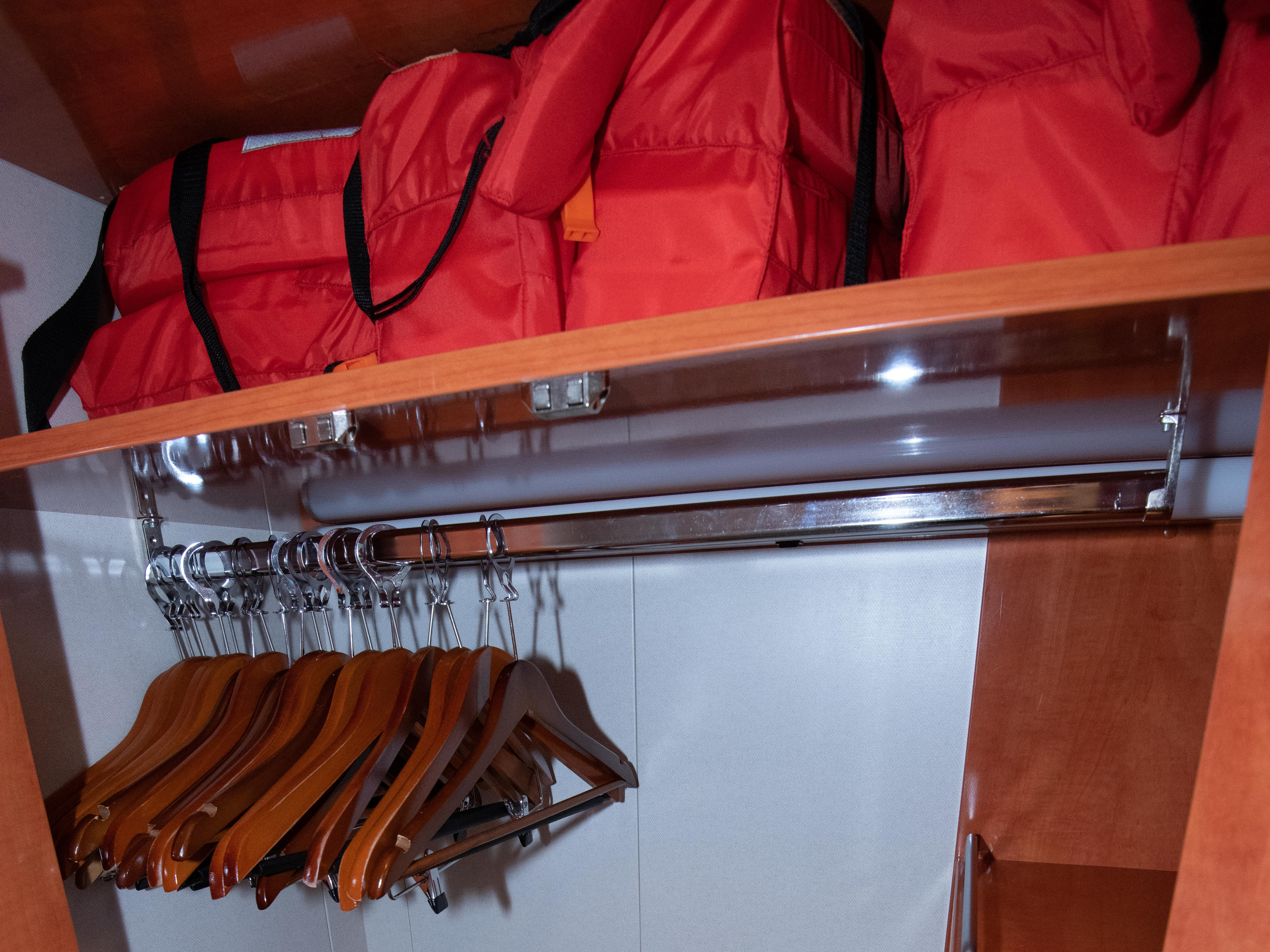 The built-in closets in balcony cabins on Pride of America have room for hanging clothes as well as additional shelf space.