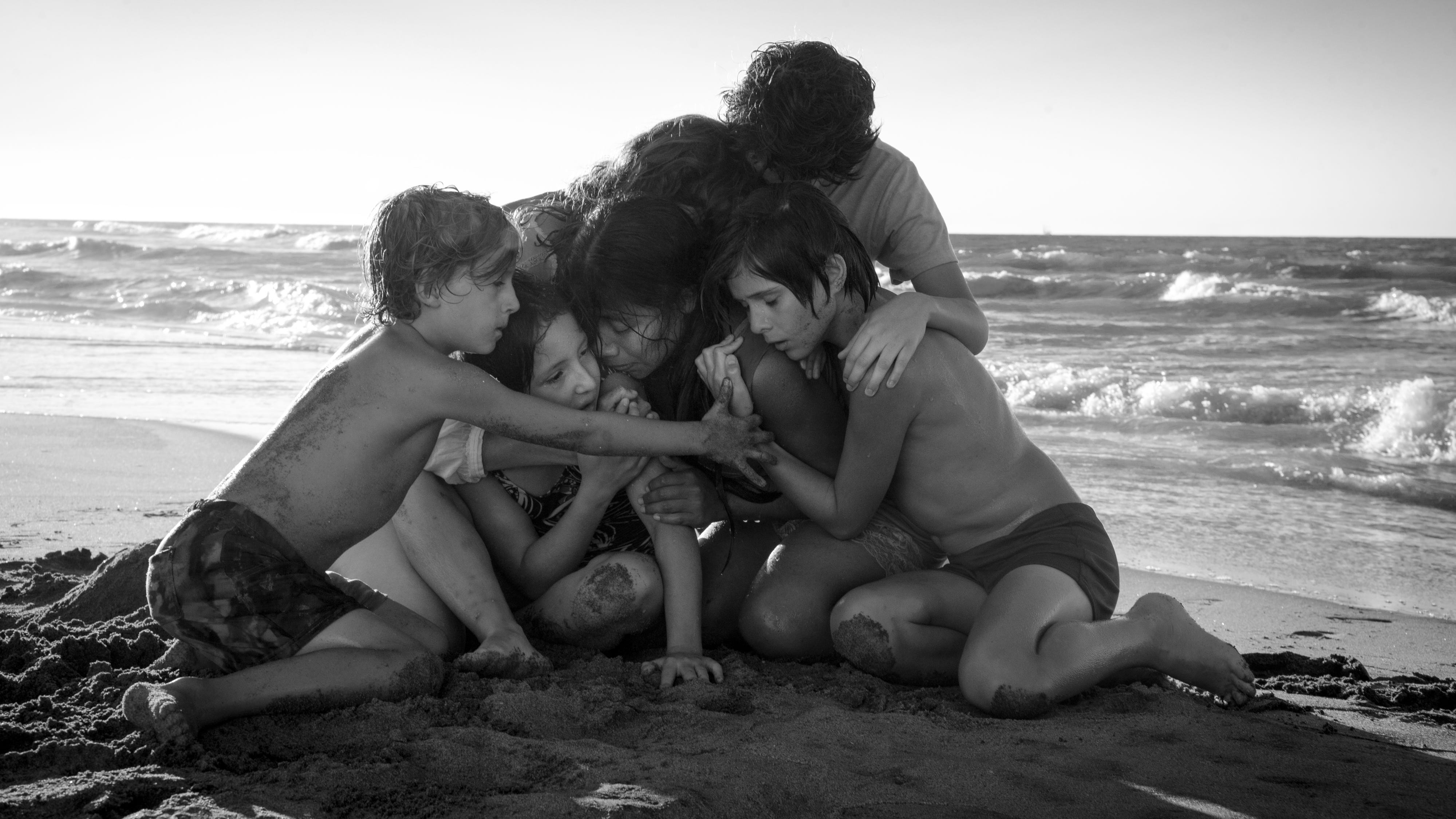 """Alfonso Cuaron's autobiographical, quietly devastating """"Roma"""" follows an upper-middle-class family and the beloved housekeeper (Yalitza Aparicio, center) who looks after them."""
