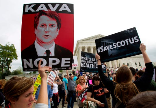 Protesters against Supreme Court nominee Brett Kavanaugh demonstrate at the Supreme Court in Washington, Oct. 6, 2018.