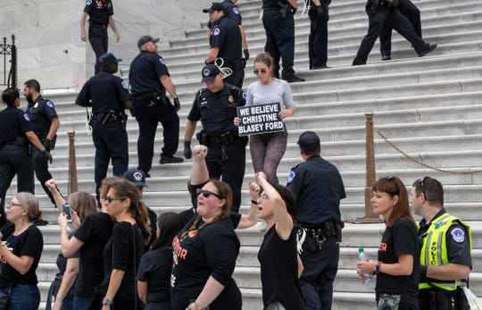 Crowds of activists are arrested after they rushed past barriers and protested from the steps of the Capitol before the confirmation vote on President Donald Trump's Supreme Court nominee, Brett Kavanaugh, in Washington, Saturday, Oct. 6, 2018.