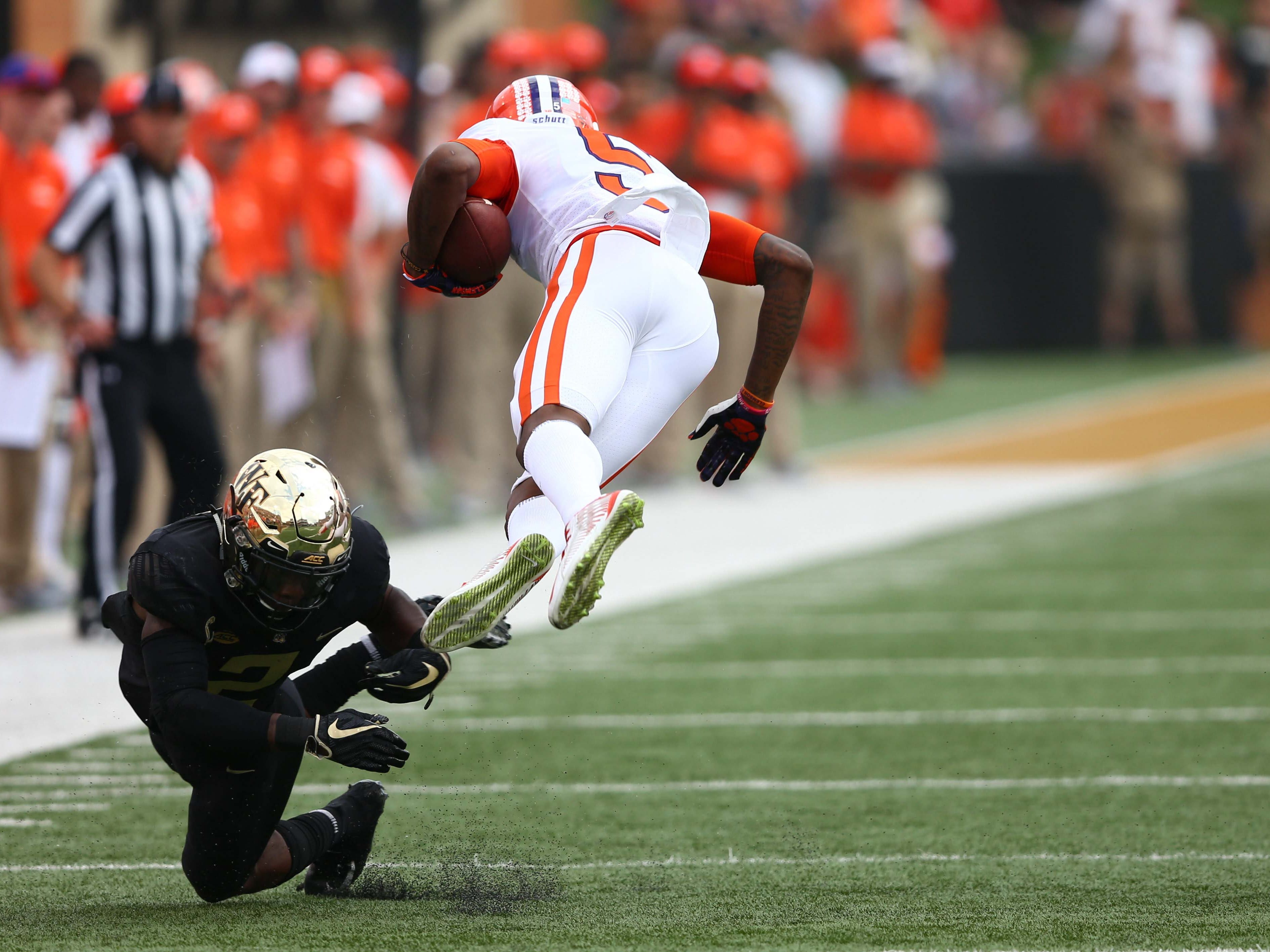 Wake Forest Demon Deacons defensive back Cameron Glenn upends Clemson Tigers wide receiver Tee Higgins in the first quarter at BB&T Field.