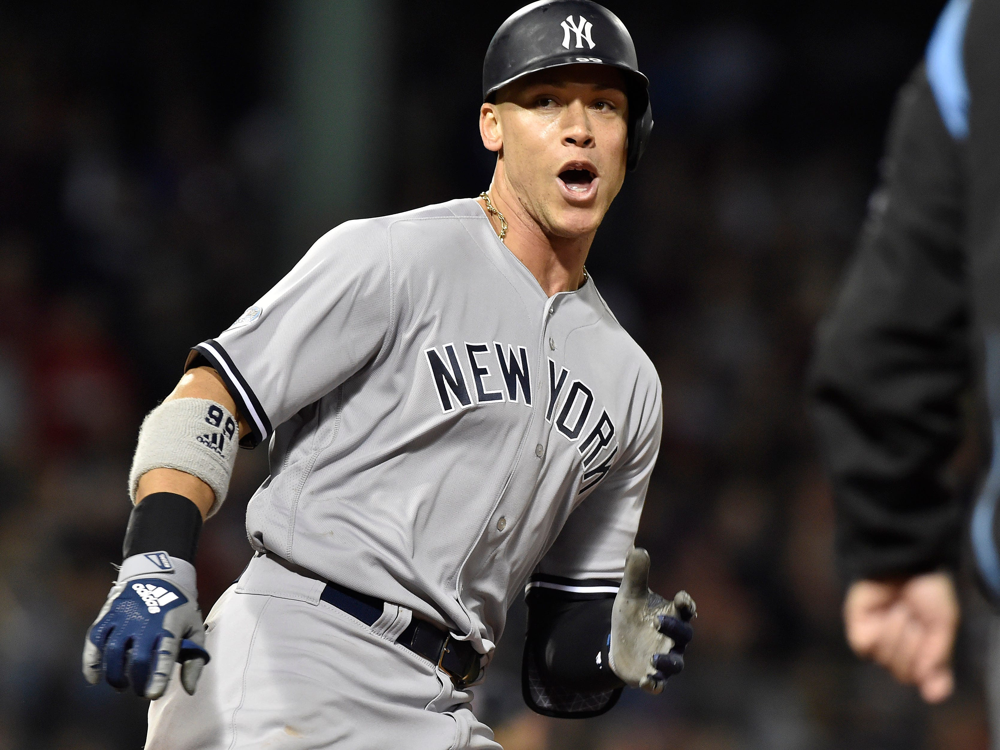 ALDS Game 1: Yankees right fielder Aaron Judge rounds the bases after a home run in the ninth inning.