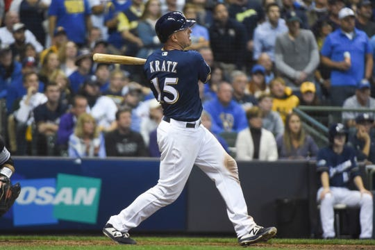 Erik Kratz hits a two-RBI single in the eighth inning Friday in his first postseason game.