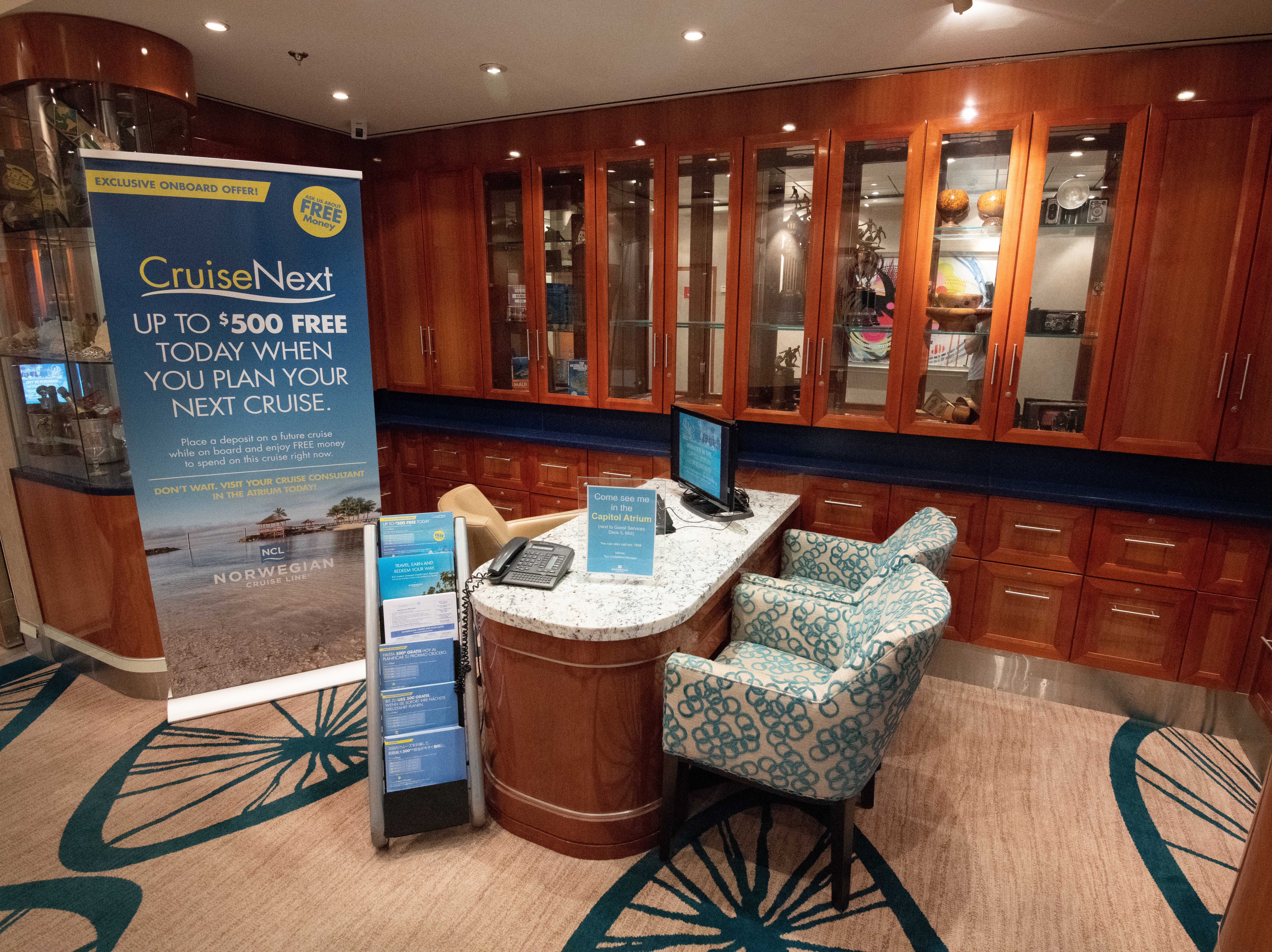 A nook in the hallway lining Deck 5 is home to a small desk where passengers can book future cruises.