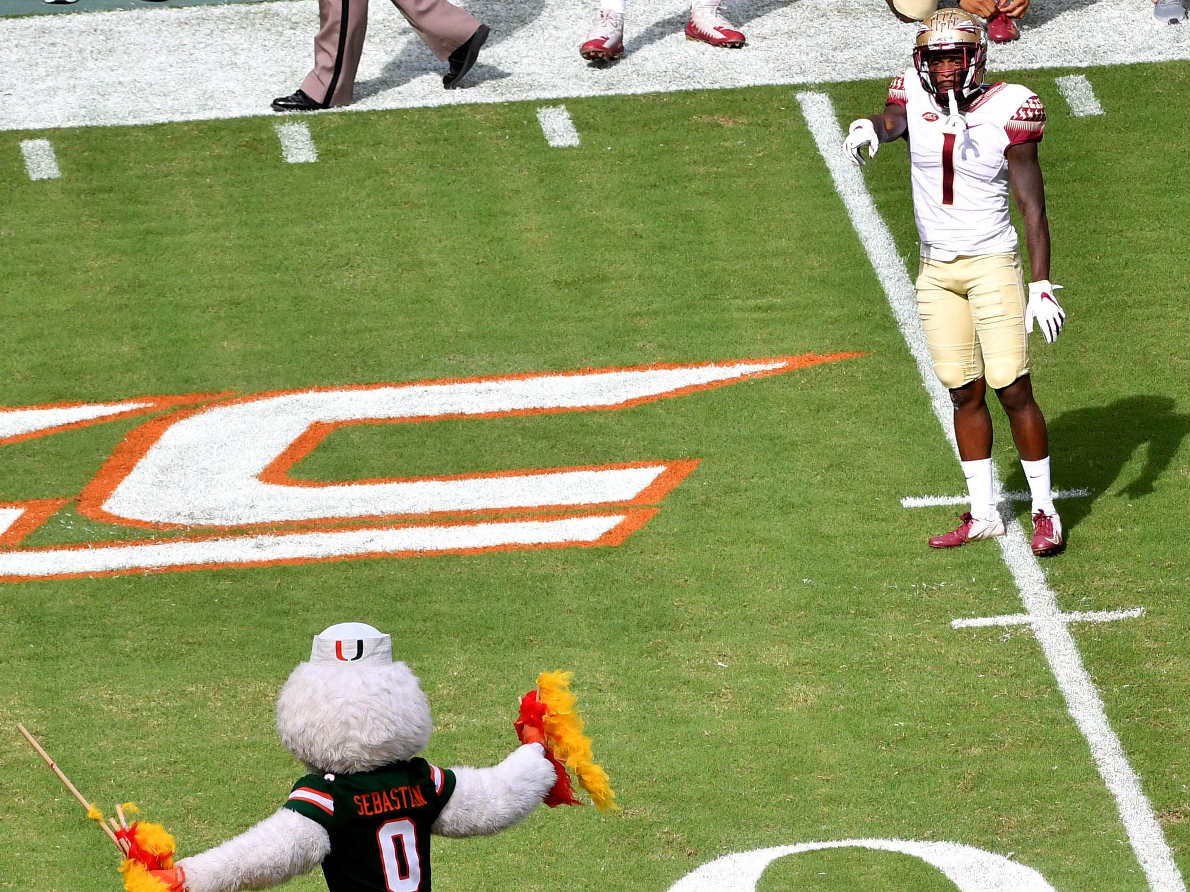 Week 6: Florida State Seminoles defensive back Levonta Taylor reacts to Miami Hurricanes mascot Sebastian celebrates before the first half at Hard Rock Stadium.