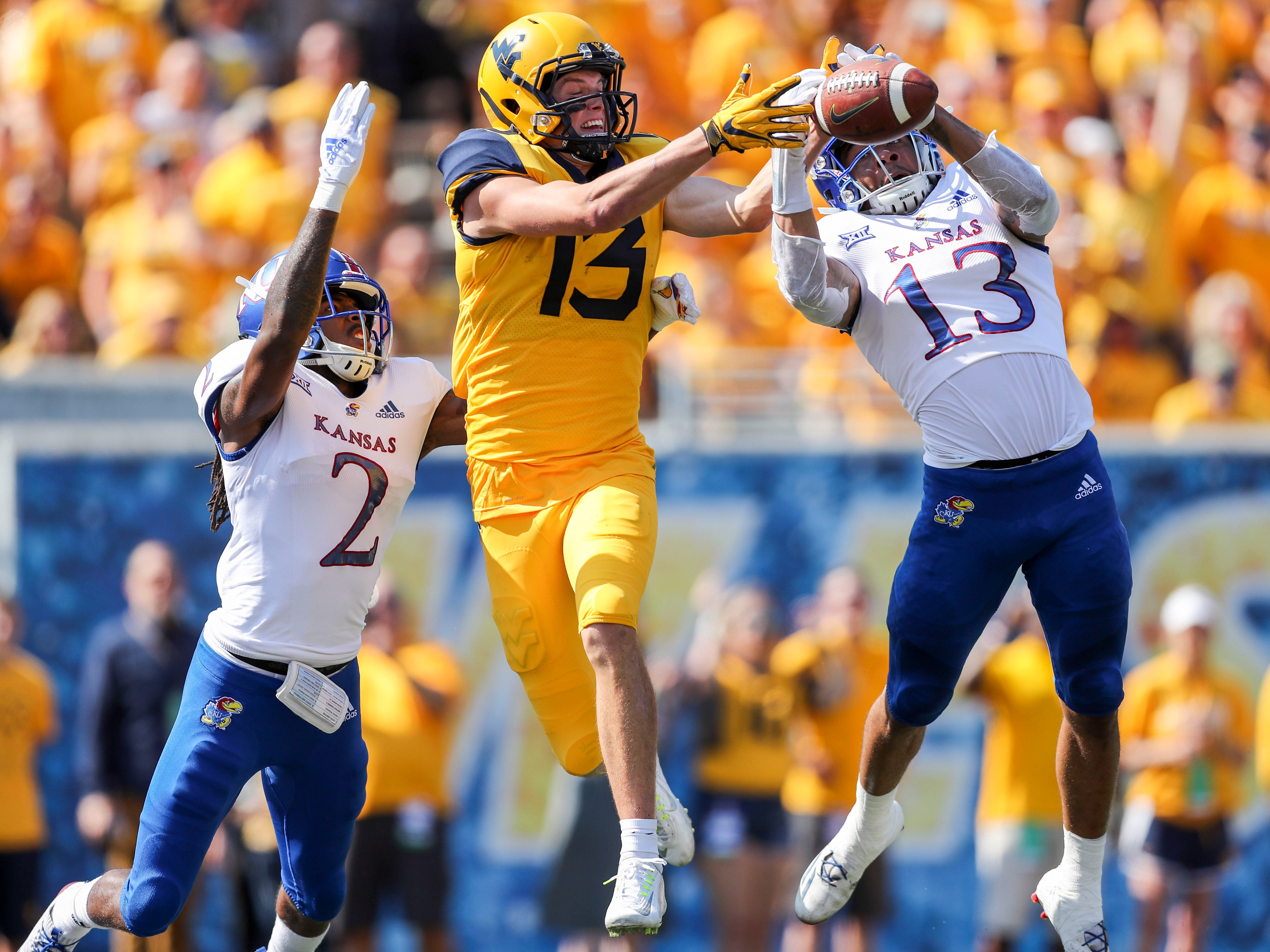 Kansas Jayhawks cornerback Hasan Defense breaks up a pass intended for West Virginia Mountaineers wide receiver David Sills V during the first quarter at Mountaineer Field at Milan Puskar Stadium.