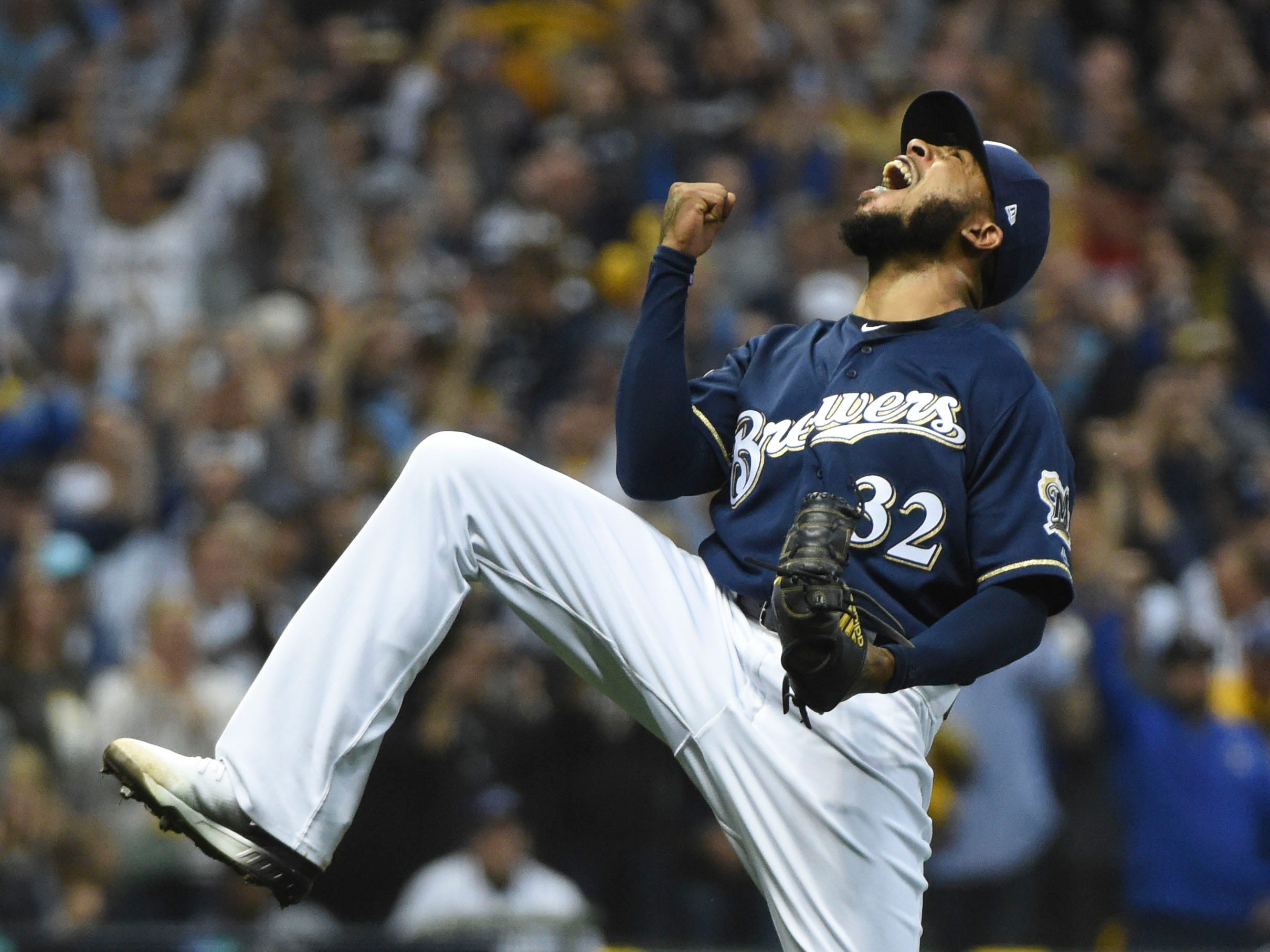NLDS Game 2: Brewers closer Jeremy Jeffress pumps his fist after defeating the Rockies 4-0.