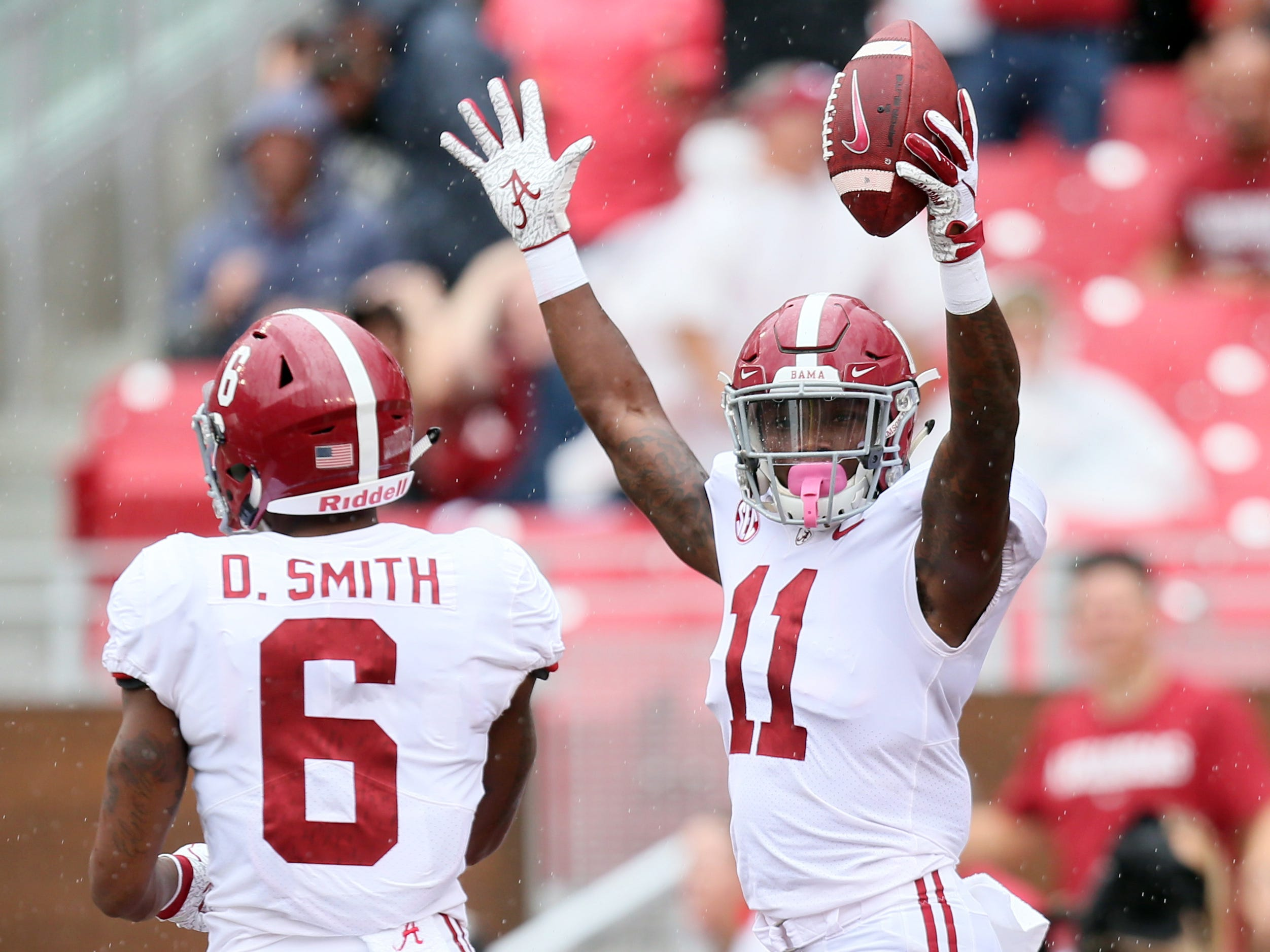Alabama Crimson Tide wide receiver Henry Ruggs III celebrates after recovering a fumble and scoring a touchdown in the first quarter against the Arkansas Razorbacks at Donald W. Reynolds Razorback Stadium.