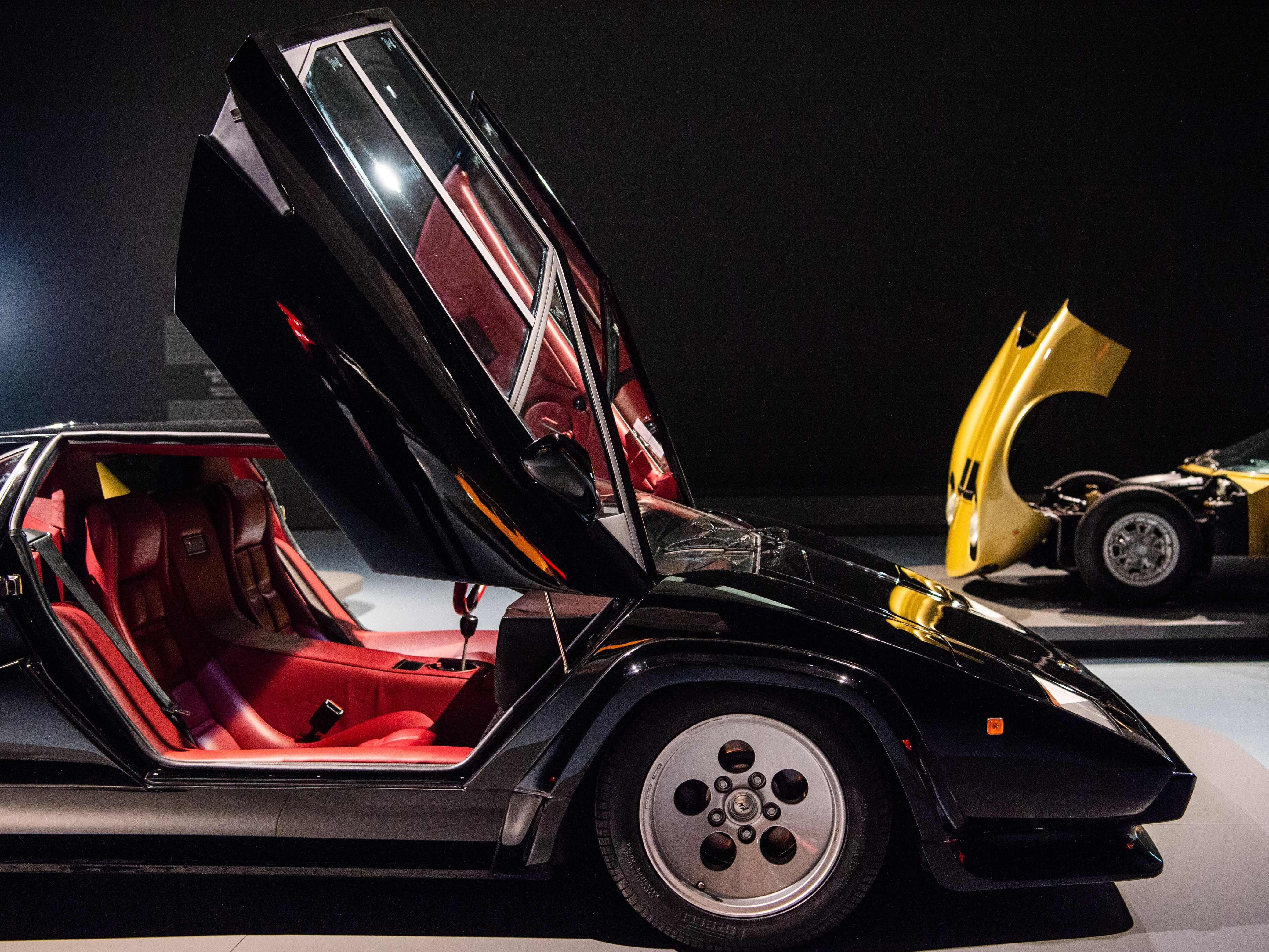 "A Lamborghini Countach 5000 QV, left, and a golden Lamborghini Miura S Serie II are on display at the exhibition ""PS: Ich liebe Dich"" (CARS - Driven by Design - Sports Cars from the 1950s to the 1970s) at the Museum Kunstpalast in Duesseldorf, western Germany, on Sept. 26, 2018."