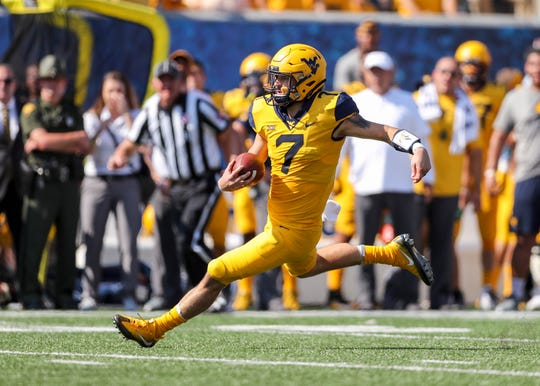 West Virginia Mountaineers quarterback Will Grier runs the ball during the first quarter against the Kansas Jayhawks at Mountaineer Field at Milan Puskar Stadium.