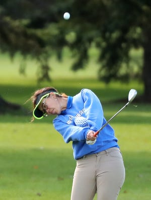 Xavier's Clair Phakamad hits from the fairway during the WIAA Division 2 regional at Mid Vallee Golf Course on Sept. 26.