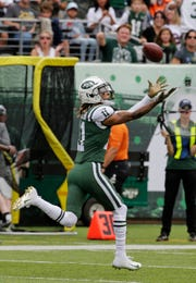New York Jets wide receiver Robby Anderson  catches a pass from quarterback Sam Darnold during the first half against the Denver Broncos Sunday, Oct. 7, 2018, in East Rutherford, N.J.