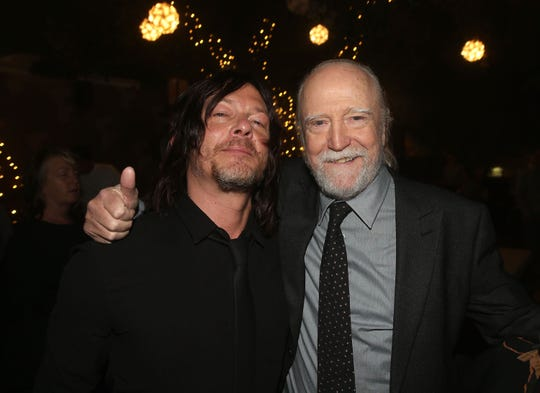 "Norman Reedus, left, and Scott Wilson attend ""The Walking Dead"" 100th episode premiere and party on Oct. 22, 2017, in Los Angeles."