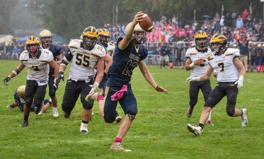 Freehold quarterback Matt Krauss, shown scoring one of his two touchdowns in the Colonials' 17-12 win over St. John Vianney, is one of the nominees fans can vote for in the Asbury Park Press Shore Conference Football Player of the Week poll.