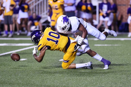 Hardin-Simmons defensive back Dedrick Strambler knocks the ball from T.J. Josey (10) for an incomplete pass against UMHB during the 2018 season. Mary Hardin-Baylor won its second national championship in three years last season, but its 2016 title is being vacated due to NCAA rule violations.