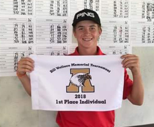 Cooper freshman Karson Grigsby shows off his prize for winning Abilene High's Bill Wallace Memorial Tournament on Saturday, Oct. 6, 2018 at Diamondback Golf Club. Grigsby won the tournament on a one-hole playoff.