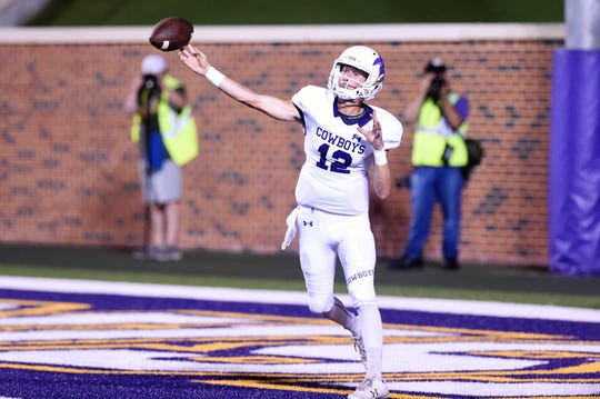 Hardin-Simmons quarterback Ty Hooper (12) lets go of a pass against UMHB at Crusader Stadium in Belton.