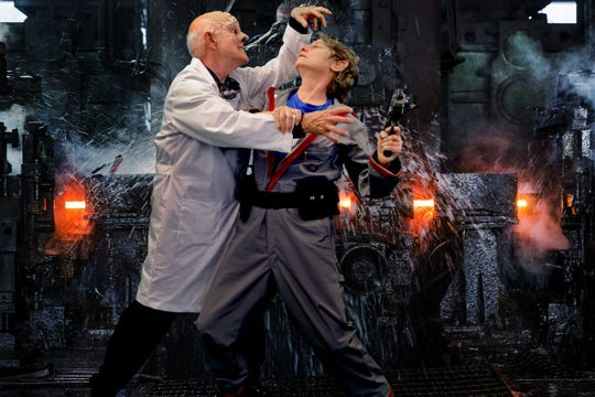 "Doctor Prospero (Nelsen Spickard, left) tussles with the Science Officer ""Michelle Hensel"" in Bainbridge Performing Arts' ""Return to the Forbidden Planet."""