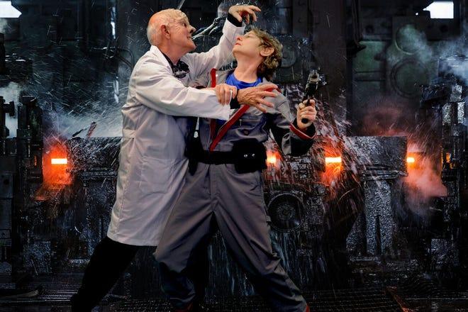 "Doctor Prospero (Nelsen Spickard, left) tussles with the Science Officer ""Michelle Hensel."""