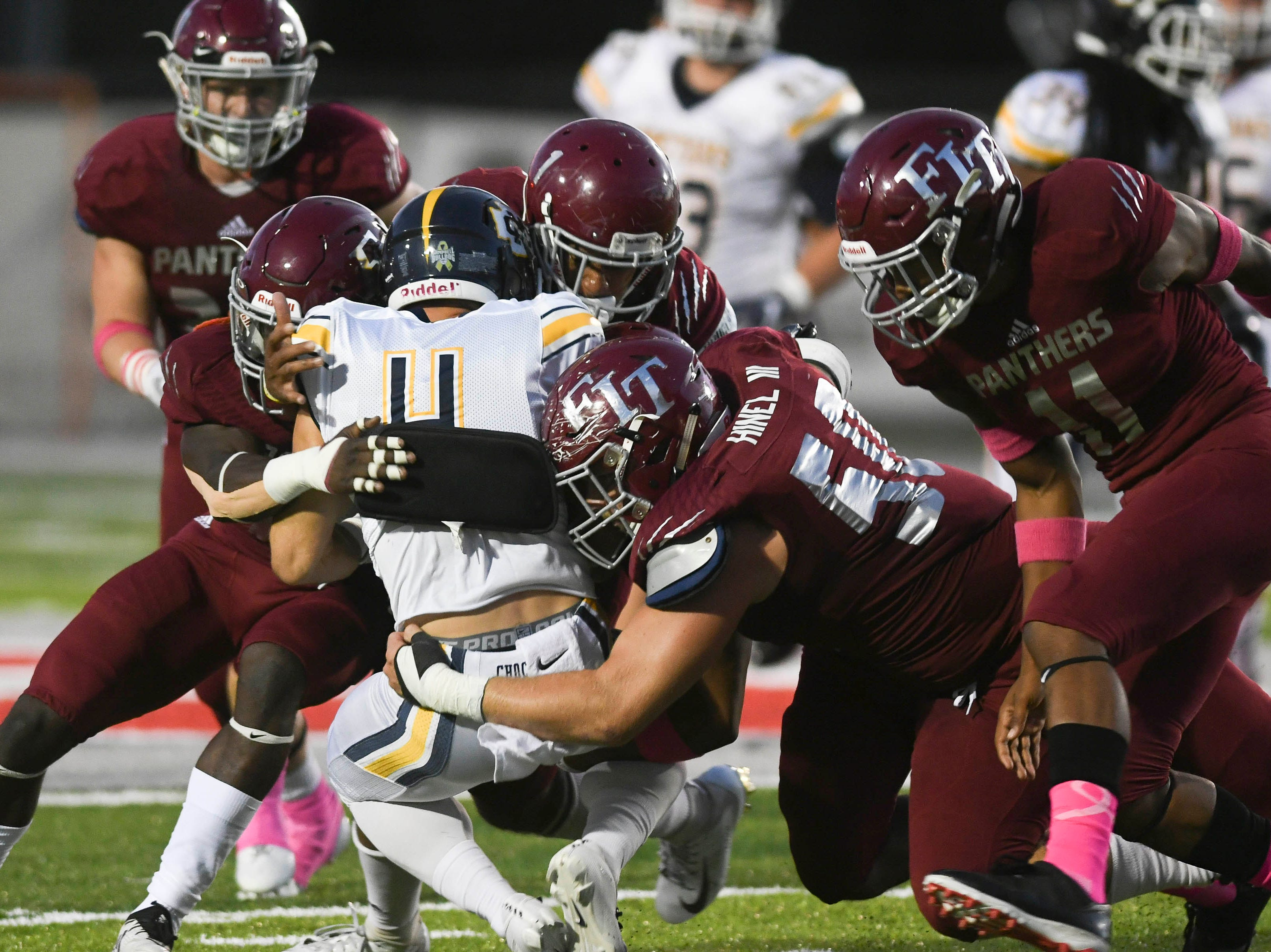 Colt Freeman of Mississippi College is stopped by a bunch of Florida Tech defenders during Saturday's game at Panther Stadium