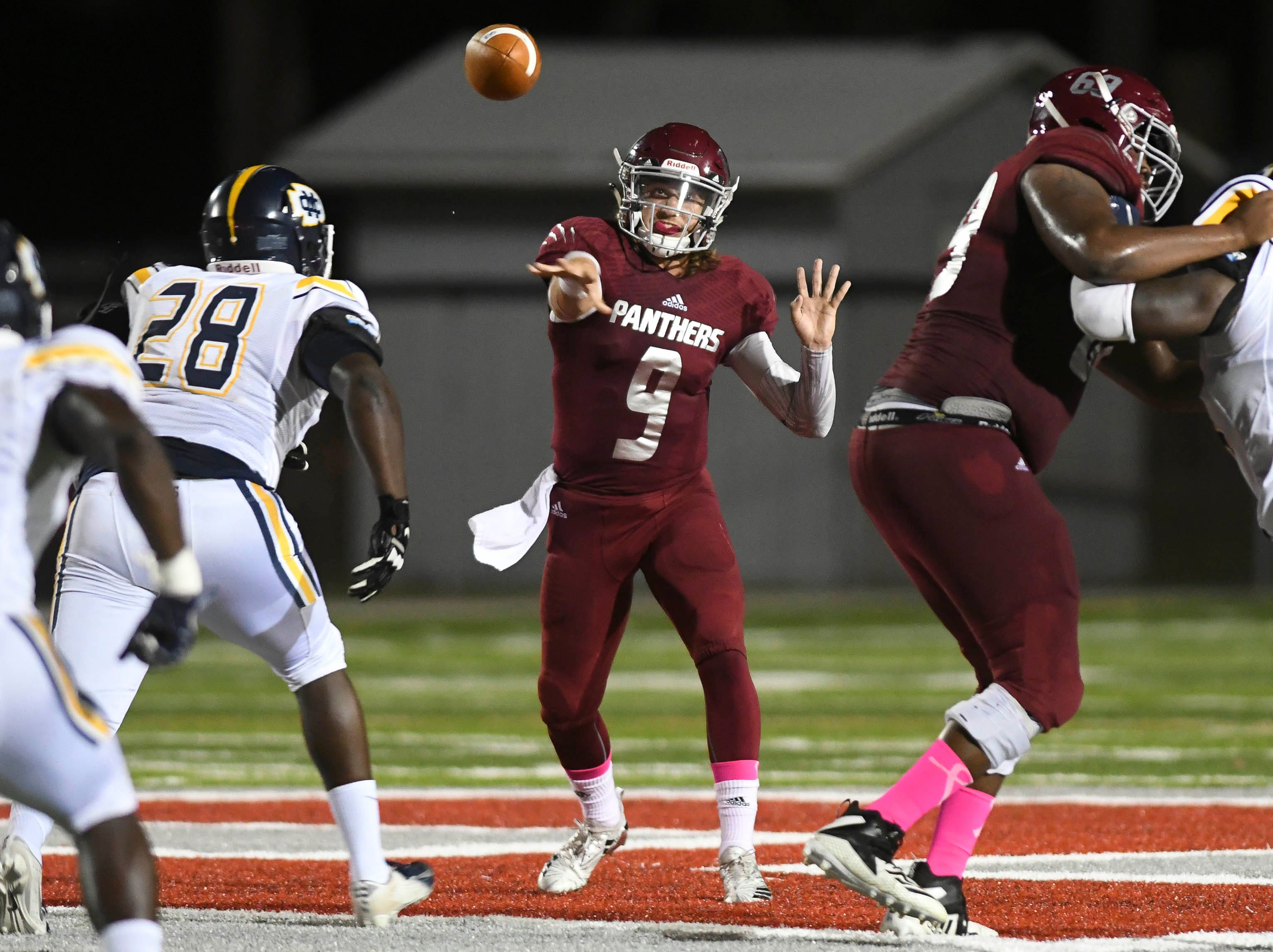 Trent Chmelik of Florida Tech passes the ball during Saturday's game at Panther Stadium
