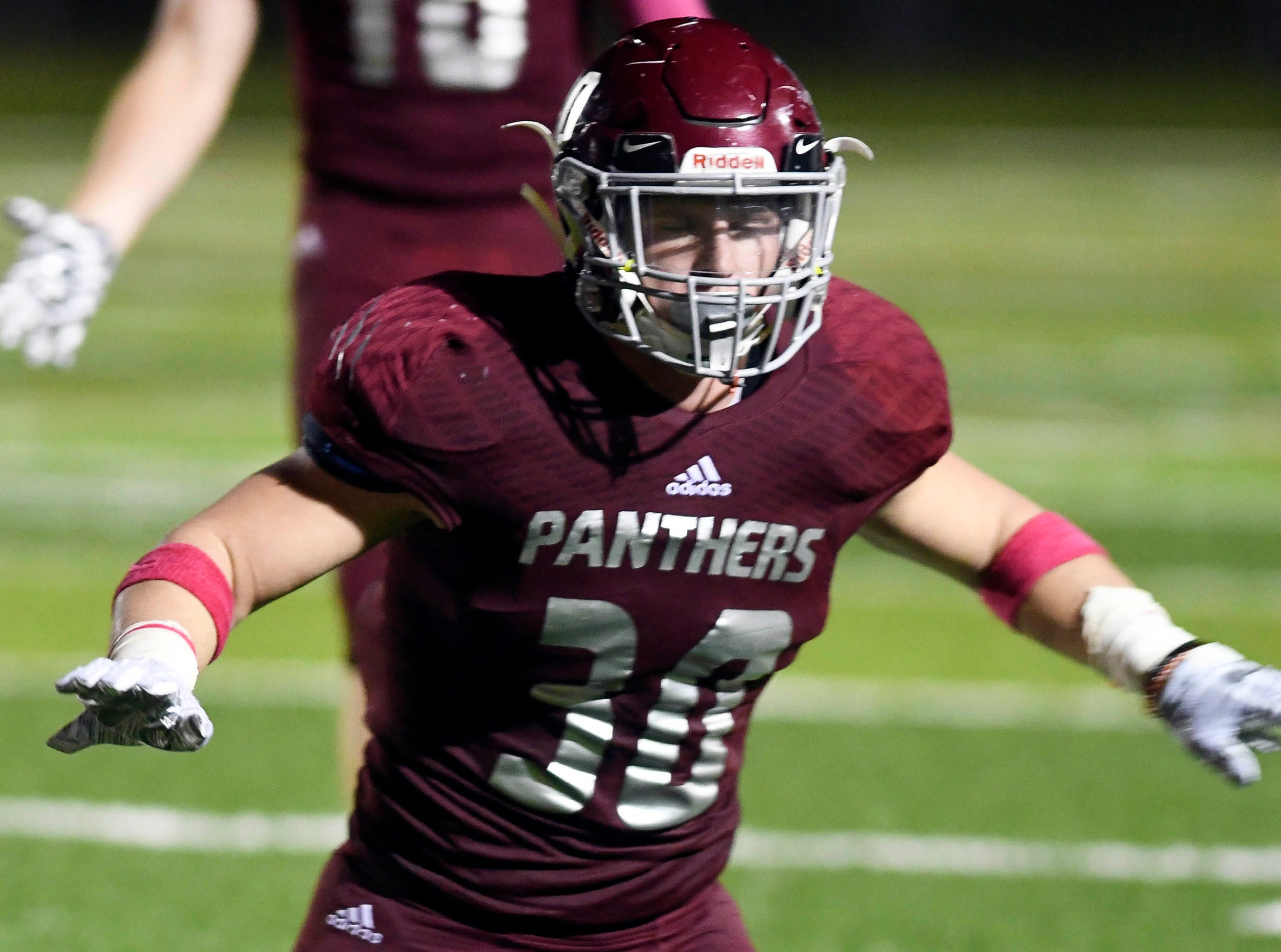 Evan Thompson of Florida Tech celebrates breaking up a pass play during Saturday's game at Panther Stadium