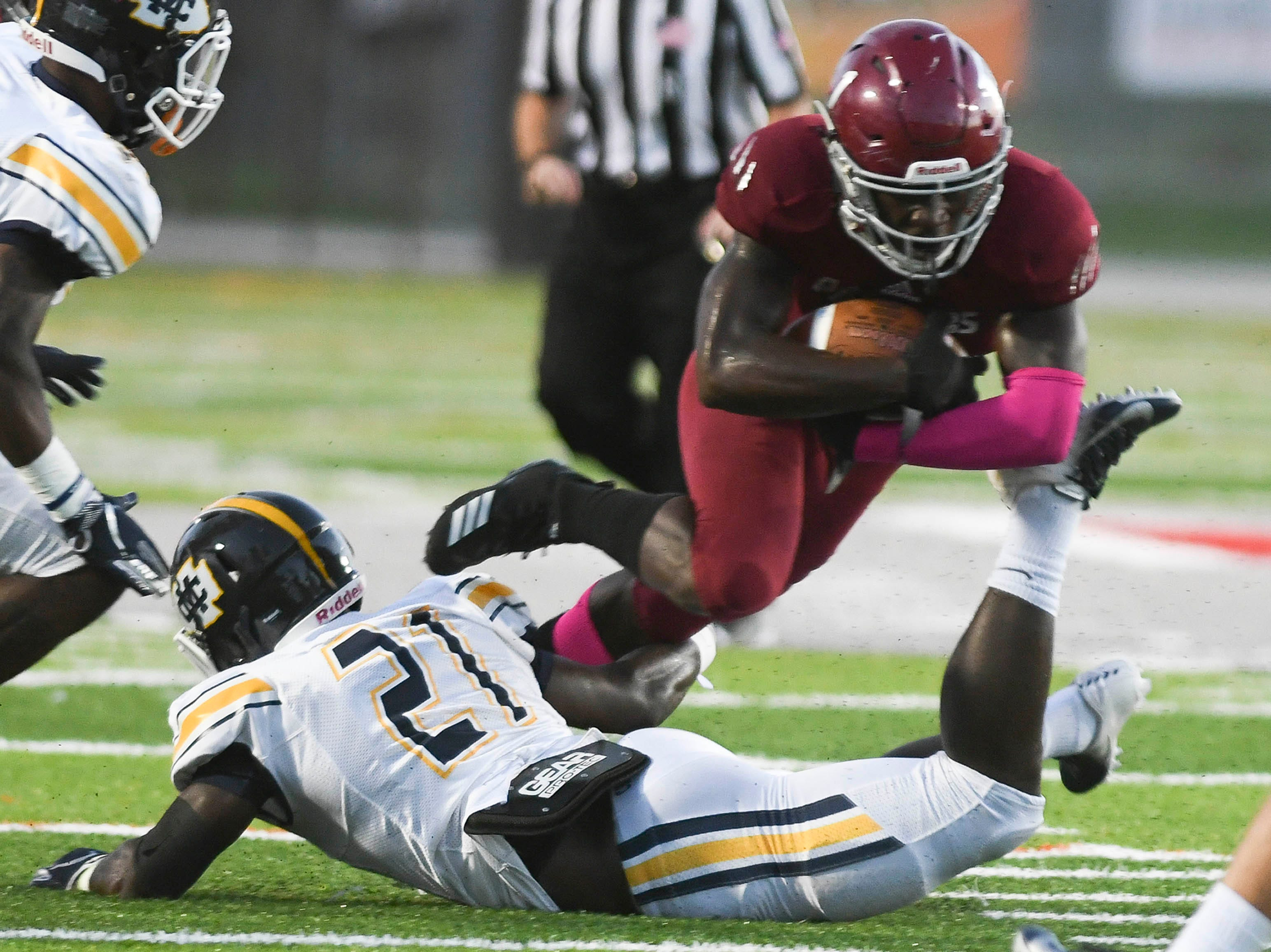 Romell Guerrier of Florida Tech is brought down by Colton Magee of Mississippi College during Saturday's game at Panther Stadium