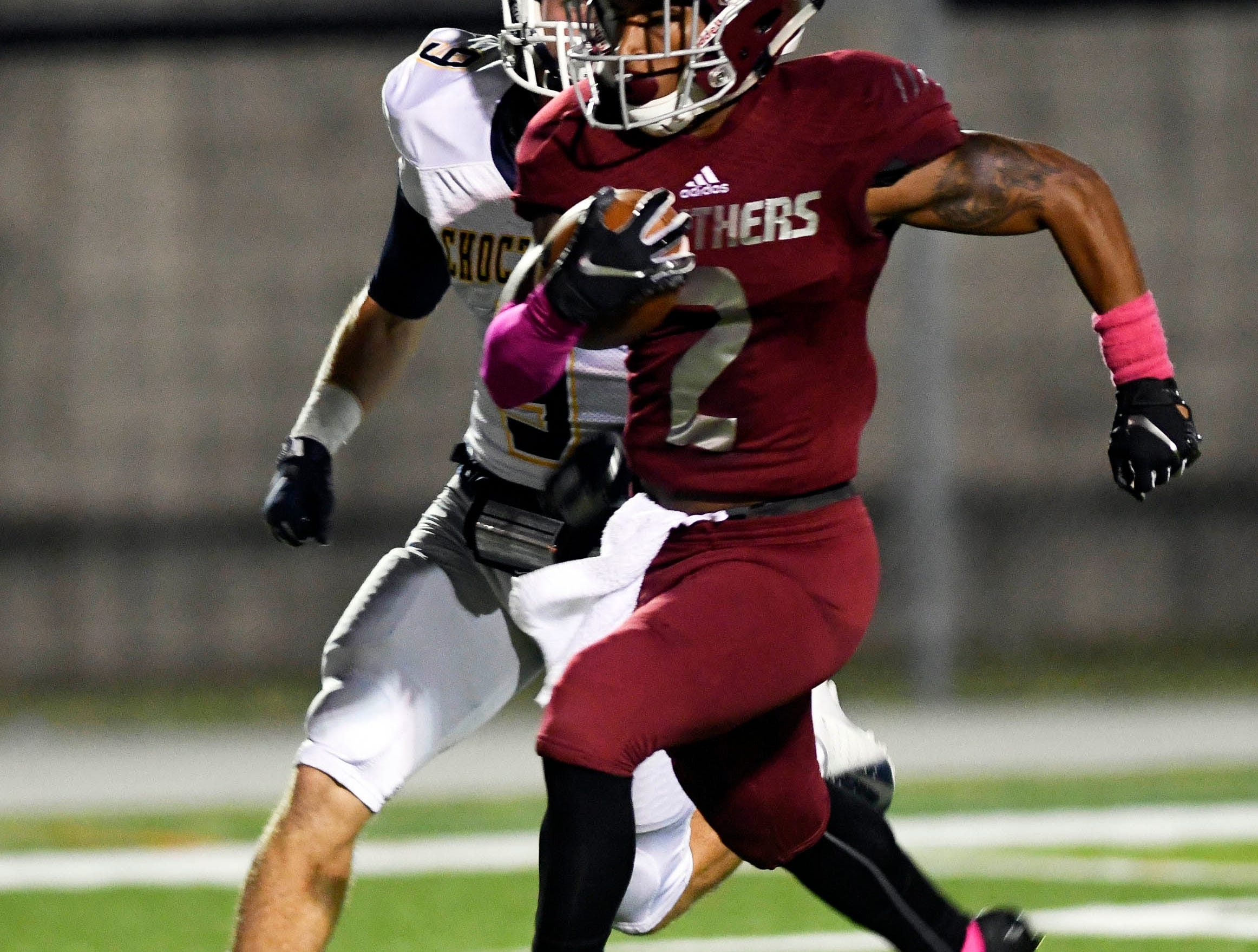 Brian Spurgeon of Florida Tech races down the field pursued by Turner Rotenberry of Mississippi College during Saturday's game at Panther Stadium