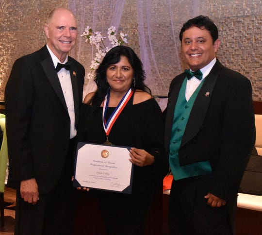 Jackie Colon, center, a former Brevard County commissioner, was one of seven Hispanic leaders honored Oct. 6 with a Congressional Medal of Recognition. She is pictured with Rep. Bill Posey, left, and Javier Molinares, president of the Brevard Hispanic Center.