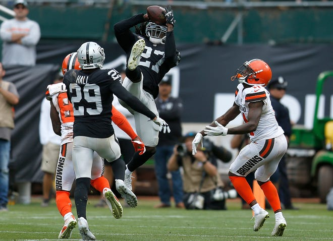 Oakland Raiders defensive back Reggie Nelson (27) intercepts a pass by Cleveland Browns quarterback Baker Mayfield during the second half of an NFL football game in Oakland, Calif., Sunday, Sept. 30, 2018.