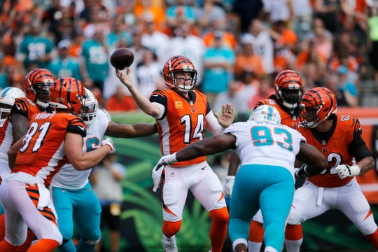 Cincinnati Bengals quarterback Andy Dalton (14) throws under pressure from Miami Dolphins defensive tackle Akeem Spence (93) in the first quarter of the NFL Week 5 game between the Cincinnati Bengals and the Miami Dolphins at Paul Brown Stadium in downtown Cincinnati on Sunday, Oct. 7, 2018. The Dolphins led 14-0 at halftime.