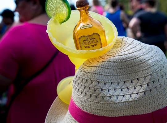 Festive hats and outfits were all over the Margarita Madness 5K race through Sawyer Point Saturday in Cincinnati, Ohio.